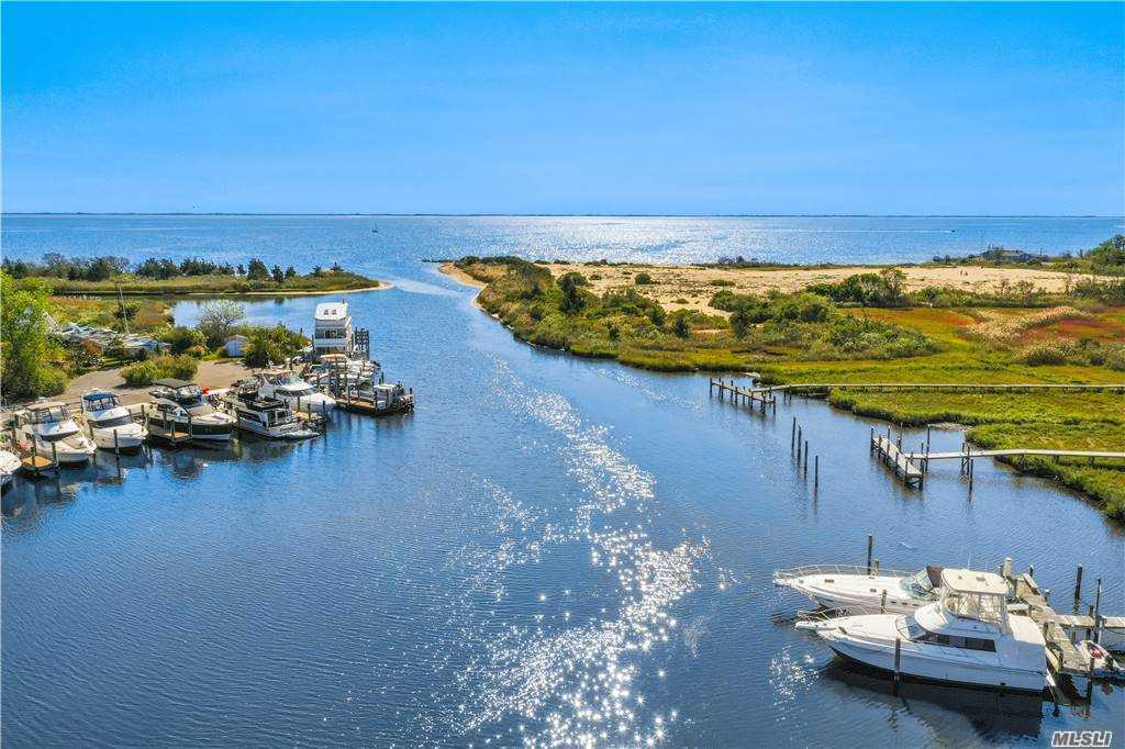Welcome home to this beautiful Contemporary Hamptons Style Water Front Home! This 3,000+ square foot home features breathtaking views, stunning updates, picturesque lighting. Scenic 400' walkway to a private dock with electric and 5 slips. The estate features a fish pond, cabana with bath and built in summer kitchen, 20x40 Gunite IG pool, handsome fire pit, and beautiful pergola. Spacious circular drive. High line's style all seasons gardens inspired by self-seeded seashore with landscape lighting. Breathtaking views of the sound, floor to ceiling sliders. Expansive multi-level decks for stunning views of the Oceanic landscape. The open concept floor plan invites you through the house, perfect for entertaining! The magnificent gourmet kitchen features skylight, stainless steel appliances, large breakfast bar. Elegant master bedroom w/ loft & private balcony, with spa-like en suite with radiant heat floors. Located between Patchogue and Bellport Villages. Welcome Home!