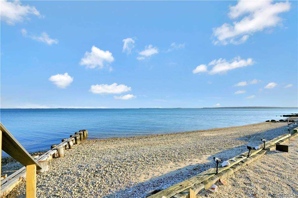 This stunning 3 br, 3 ba home sits directly on Peconic Bay with breathtaking views of Bug Light, Orient Harbor, Orient State Park and Shelter Island.   Enter through the private gates and enjoy all this property has to offer that includes a new Trex deck, she/hobby shed, gorgeous new kitchen, open floor plan, new bathrooms and a second floor master suite with balcony.