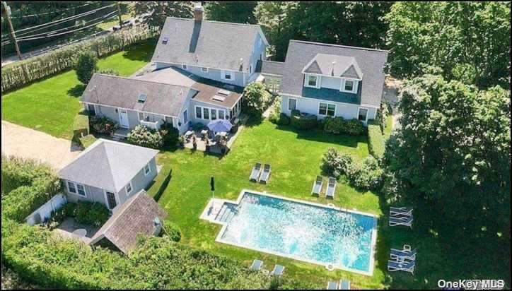Time to make that live/work change! Take over unique turn-key, existing high-end Bed & Breakfast, or create a private compound, or use as investment opportunity. The White Fences Inn is a beautiful, profitable, completely & recently renovated luxury lodging, centrally located in prestigious Water Mill Southampton. This popular B & B offers a cool, modern aesthetic while maintaining the abundant charm of this iconic Hamptons town, with manicured grounds, lovely pool and luxury amenities. Includes spacious separate owner/manager quarters, abundant common areas, private guest suites with radiant heat, meeting space and more.