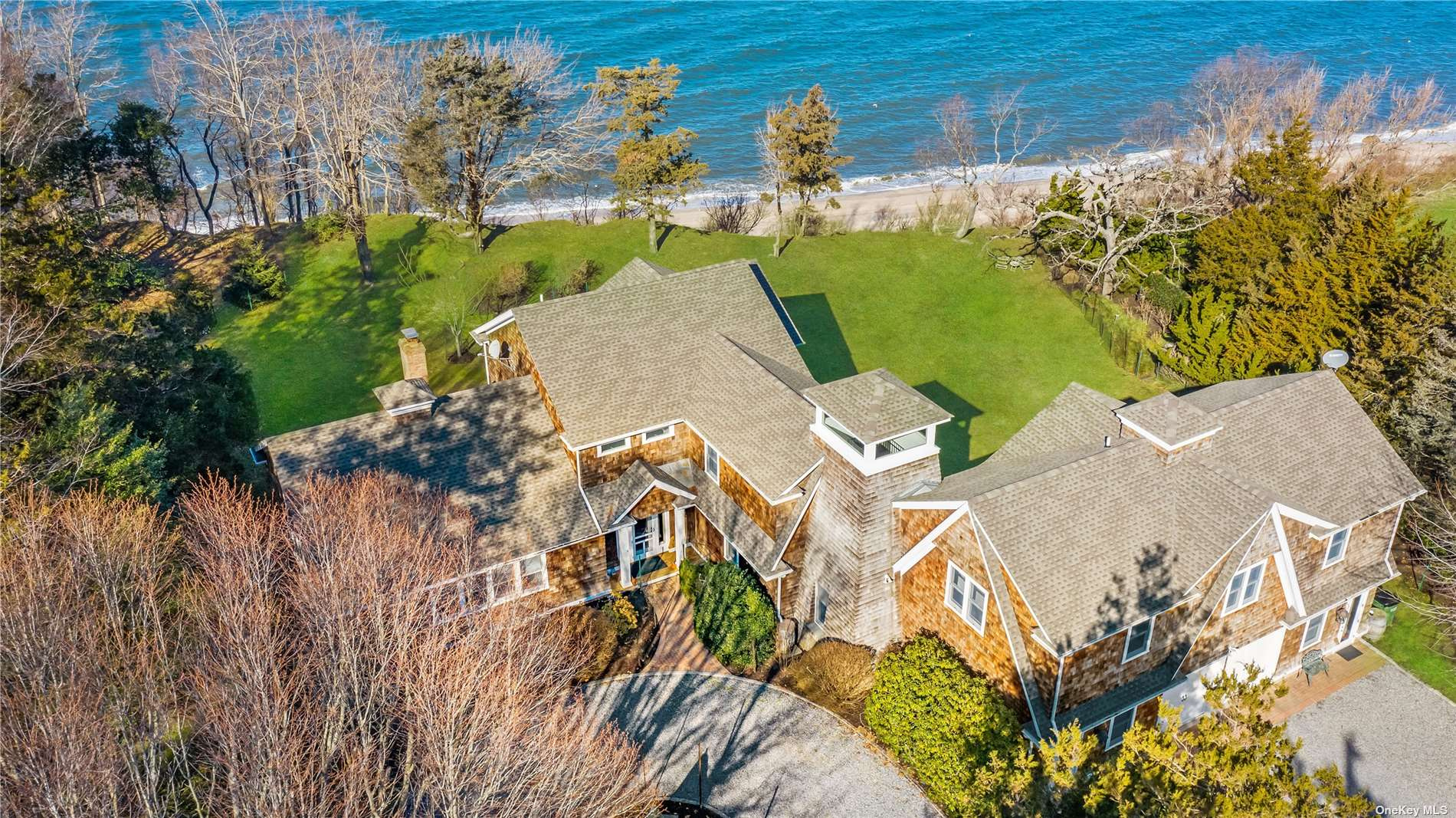 Head Down Your Long Private Driveway Boarded by Gorgeous Cedar Trees  Greeted by Your Stylish and Welcoming Cedar Shingle Home on the Sound. Hear the Water, Take in the Views, and Bask in the Nature Around You! This Home has Wonderful Generous Open Rooms all Facing the Water. Beautiful E-I-K Open to Dining Rm w/ Sliders Leading  to the Patio, Living Rm w/ FP, 2 guest beds on the 1st floor, Oversized Pantry, Laundry, and Foyer.  Upstairs the Primary Ensuite is to die for! Fully Renovated in 2017 w/ Magnificent Views,  Luxurious Bedroom & Bath, Huge Walk In Closet, Office/ Library, Storage, and Observation Tower. Accessory Apartment is Large Featuring 2 bedrooms, Open Concept LR, DR, Kitchen, Amazing Views and a Large Balcony.  Staircase Leading to Your Own Private Beach Stretching 200 Ft!  This is Your Opportunity to Own Your Dream Home!