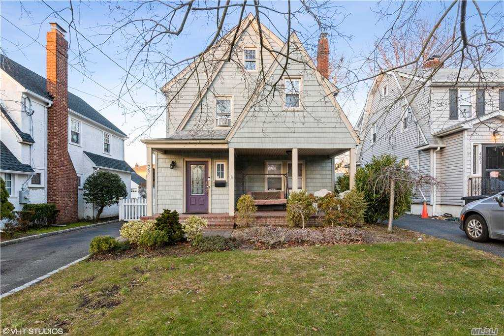 Mint Tudor Colonial w/ Granite, Wood and Stainless Steel Eat In Kitchen. Updated Baths, Siding and Windows. Beautifully Bricked Front Porch, Gas Heat. Walk up Attic can be 4th and 5th Bedrooms. Private Fenced Yard, 2 Car Garage Detached Garage, Updated Electric. Great Block- Near LIRR, Shops and Worship.
