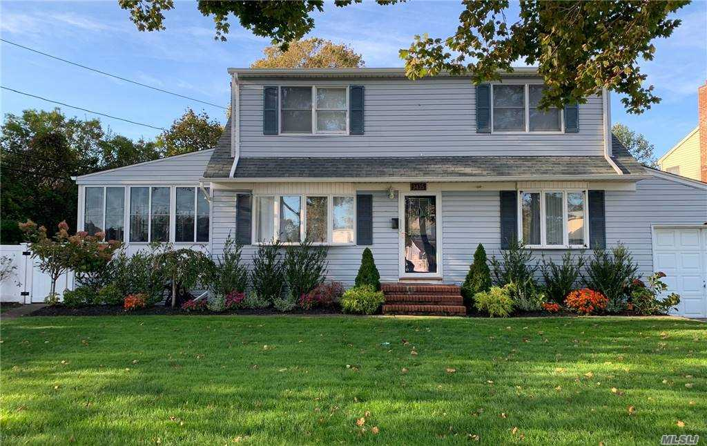 Wonderfully located spacious Colonial in desirable Wantagh Woods offers wood floors, new ductless AC, new gutters, new blue tooth in-ground sprinkler system, lush landscaping, new doors, new washer/dryer and beautifully renovated basement. Close to Railroad, shopping and Wantagh Elementary. Great for entertaining this home boasts large enclosed porch, formal DR, LR, home office, 15x20 Den with skylights and French doors to inviting deck, 3BR w option for 4th, 2 Full baths. Taxes do not reflect STAR exemption. A must see!