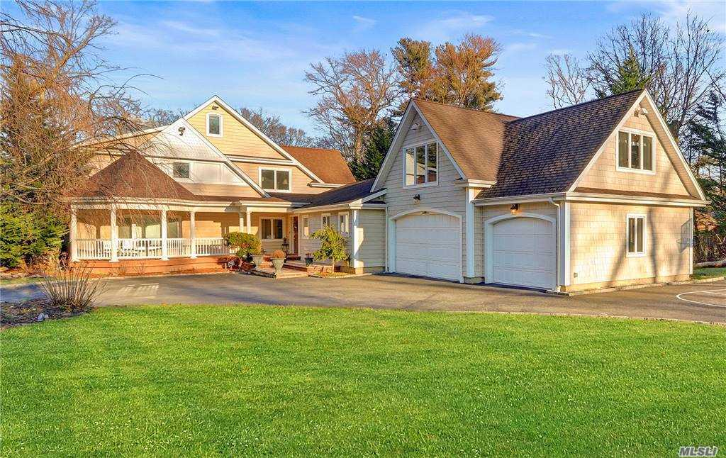 Diamond Colonial on 1.78 Acres of flat property. On private cul-de-sac less than 1/2 mile to the LIRR. Grand custom eat-in kitchen w/gas cooking. Custom Millwork throughout. Radiant heated Bathrooms. In-ground pool, outdoor kitchen. Great home for entertaining! Award winning Syosset Schools. 2022/2023 TAX GRIEVANCE SETTLED PRICE REDUCTION ABOUT 18%!!!!