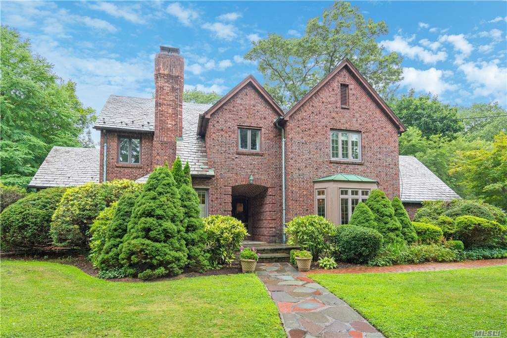 Exceptionally elegant and charming brick Colonial located in the desirable Midland section of CSH. Appointed with Vermont slate roof and copper gutters. Boasting a spacious dining room and great room with authentic millwork and fireplace. Eat-in-kitchen equipped with stainless steel appliances overlooks level, fenced in backyard with mature stately landscaping and patio. Both full bathrooms have been recently updated, master bath having separate tub. Laundry room conveniently located on second floor. Ideal location close to village shops, restaurants, Eagle Dock Beach (beach and mooring rights), nature trails, schools and railroad.