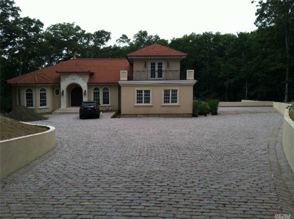 "133 Northside Dr. Northside Hills Southampton, NY 11963 TUSCAN VILLA Custom Built By Owner Built 2012 1 1/2 acre plot Stucco with Clay tile roof, copper drains, Anderson windows, custom made metal double front door Cobblestone Driveway approx 5,500 sq ft Gunite Pool Heated 20'X 40',8' Deep with 8'x 8'Spa situated on a 3,000 sq ft Travertine patio with pizza oven imported from Italy Covered deck 4 Zone heat/air 2 Boilers Heated Floors in basement and garage 6,900 sq ft living space 3 Car Garage 708 Sq ft with Mahogany doors 7 Bedrooms 6 1/2 bathrooms Jacuzzi in master bath 2 Marble Fireplaces Custom made 8 ft mahogany doors to all rooms and closets Gourmet Kitchen with Island that seats 3 with granite top 2 Copper sinks one on the island 2 Bosch Dishwashers one on the Island 1 48"" Wolf oven with custom made copper hood 1 Sub zero Refrigerator 1 sub zero freezer 1 wine cooler Miele built in coffee maker"