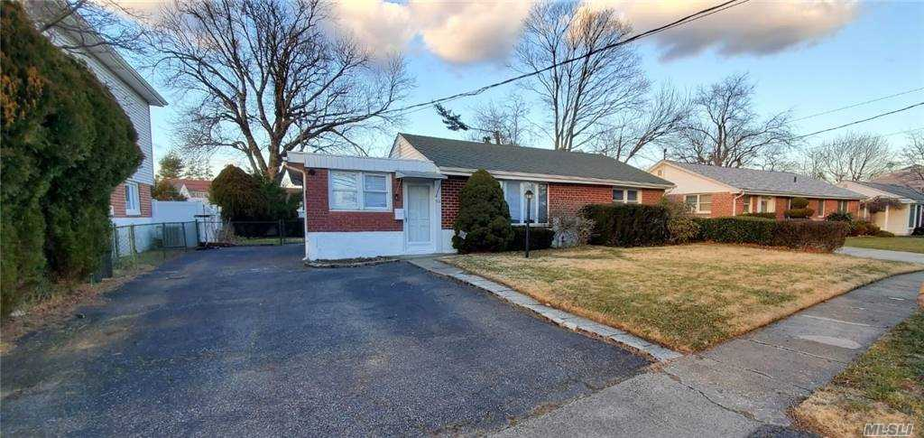 Benefiting From Intriguing Features, An Attractive Location. This Exquisite Home sit on a 60x101 lot, Is Renovated New Kitchens With Granite, New stainless steel appliances, Wood Flooring Throughout, Light Fixture, Full Finished Basement, New Sidings, new Windows, Design ceiling. Close to all Amenities