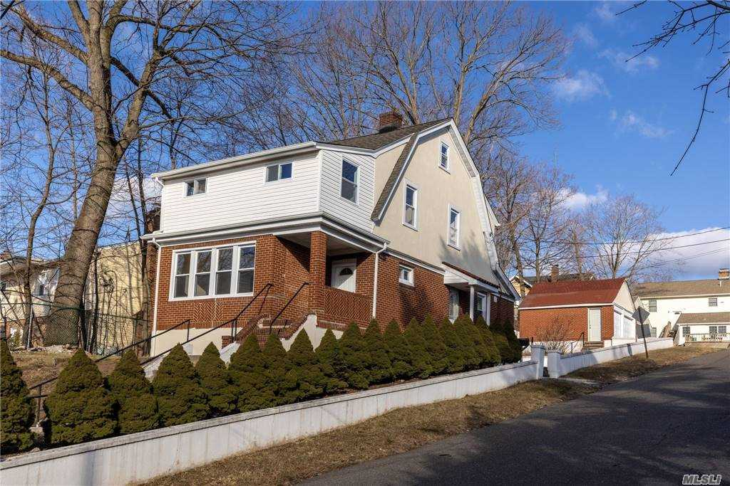 This Stunning Turnkey Property Is Ready For You To Call it Home! Located In The Popular Neighborhood of Glen Cove You Will Find This Home Perfectly Located Near All Amenities. 3 minute drive to the LIRR. Situated On A Large Lot This Property Includes A Two Car Detached Garage, A Full Finished Basement, State of the Art Kitchen, Living Room, Formal Dining Room, 3 Spacious Bedrooms, 2 Full Baths.