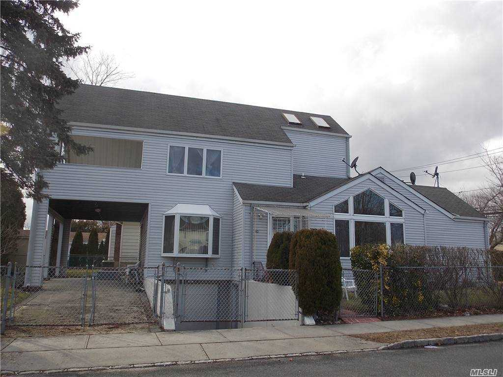 Spacious 4 BR With  soaring ceiling in living room, FDR   W/sliding door opens to back patio. Eik, Large Master room with Vaulted celling has Its own large deck through sliding glass door-perfect for evening wine or morning coffee, Office (room) with separate outside entrance, which is perfect for any profession, CAC on 2nd floor, fully furnished basement with outside entrance,