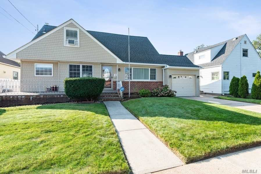 Mint Condition Expanded Cape Home Located in the Village of Floral Park. Situated On An Over Sized Lot, This Must See Home Features 5 Bedrooms, 3 Full Baths, a Living Room and Formal Dining Room with Hardwood Floors, Eat in Kitchen with Stainless Steel Appliances & Granite Countertops. Additional Interior Features Include Heated Bathroom Floors and Attic Fan. Full Finished Basement with Laundry Area and Separate Outside Entrance. Exterior Features Include 1 Car Attached Garage, Private Driveway, Front Patio and Large Fenced Backyard.