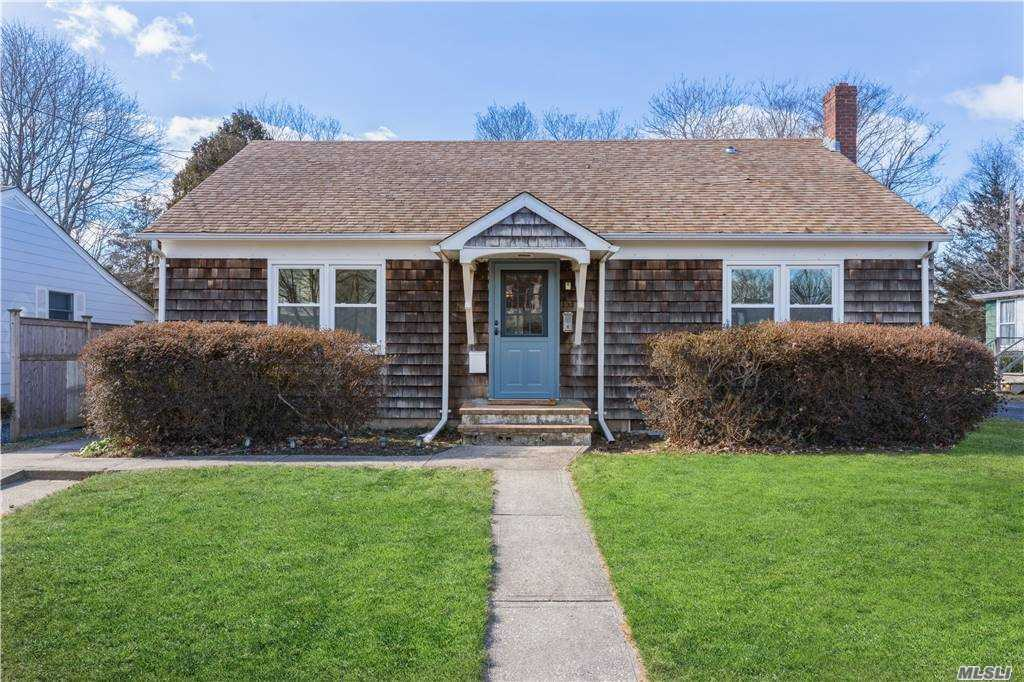 Ranch home in one of the finest locations in Greenport on 6th Street.  Step on the sidewalk and view the water at the end of 6th Street where a beautiful park and beach await you.  This cedar shake shingled home has a comfortable and cozy layout with its original hardwood flooring.  Nice back yard with shed included.