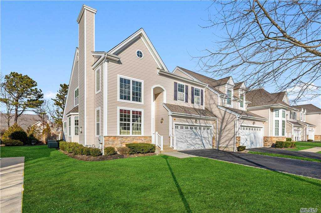 ENJOY THE SWEET LIFE!  Your easy, carefree lifestyle awaits. Set within private secured gated community of the well sought-after Vineyards at Moriches. Brimming with lifestyle credentials, the community offers a clubhouse, gym, IG pool, tennis encircled by lovely scenery set behind the privacy of mature evergreens. This home consists of soaring ceilings in the living area which enhances its spacious look. The focal point of the living room is the stone fireplace which in turn leads to the spacious DR where hosting large dinner parties will be a breeze. A beautifully appointed kitchen w/sleek cabinetry, granite countertops and SS appliances are joined by a casual den. The 1st floor MBR en-suite is completed w/ beautiful natural light to ensure a serene start to the day.  The upper level consists of a spacious guest bedroom, full bath ang relaxing loft area, the perfect spot to curl up with a good book. Be prepared for this to be 'love at first sight'. Virtual Staged Pics