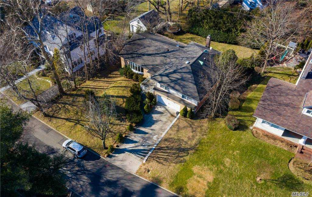Beautiful renovated home in Great Neck Estates. This home has an open floorplan which is perfect for entertaining.  The new chefs eat in kitchen Includes Top-Of-The-Line Viking Appliances. This home has everything you need from oversized rooms, Large deck, stone patio, new hardwood floors, 3 full modern baths, electric and wood burning fireplace, 4 large bedrooms, finished basement, gas, sewer, central air, low taxes, close to houses of worship, parks schools, and much more.