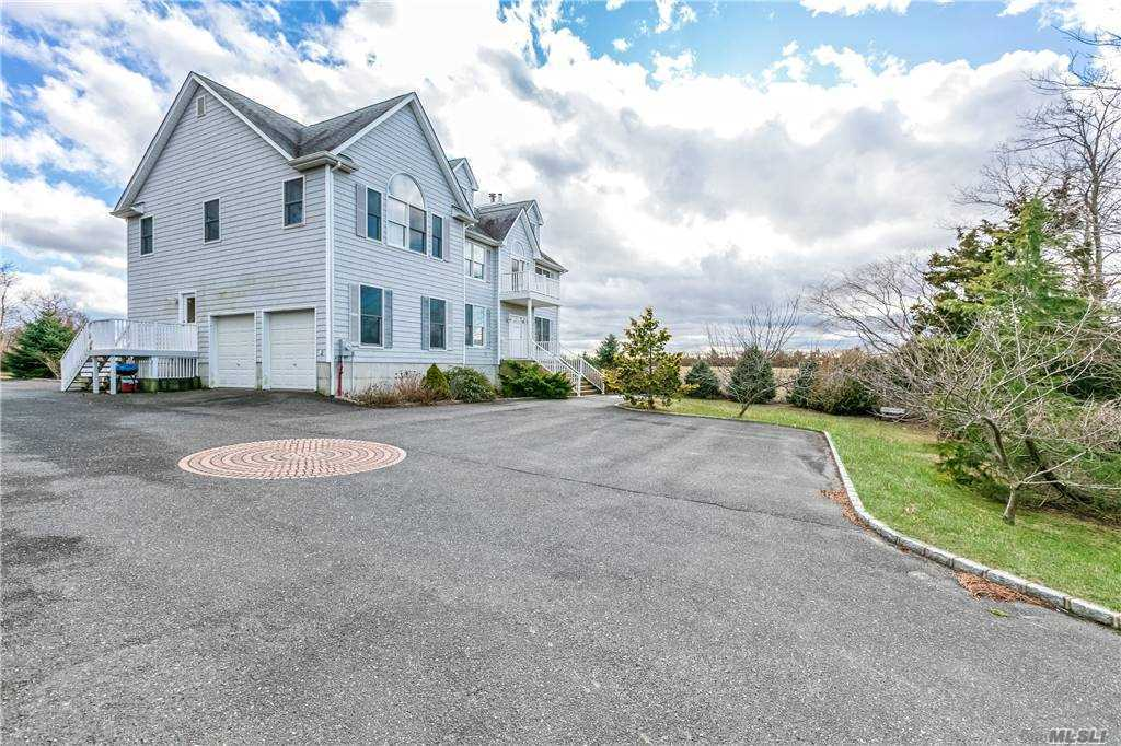 Spacious is the word for this Contemporary home that's set on 1-acre flag lot. Property Abuts acres of farmlands and gives you a serene setting and a bonus of peek-a-boo views of the Long Island Sound. Built in 2005 and offering 2x6 construction, Hardwood floors, fireplace, Maple kitchen cabinets, stainless steel appliances and granite counters. When I say spacious consider 5 Bedrooms and 5 bathrooms! Backyard Paving stone patio is ready for entertaining and yard offers room for a pool -tennis and 5 minutes to the beach !