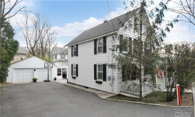 Colonial Home in Heart of Roslyn, Roslyn Schools, Stainless Steel Appliances, Hard Wood Floors Throughout, Hi Hats, Full Finished Basement, 2 Car Detached Garage, Patio, Corner Property, Close to Village Shops and Restaurants, Minutes to Parkways and Northern Blvd and Public Transportation.