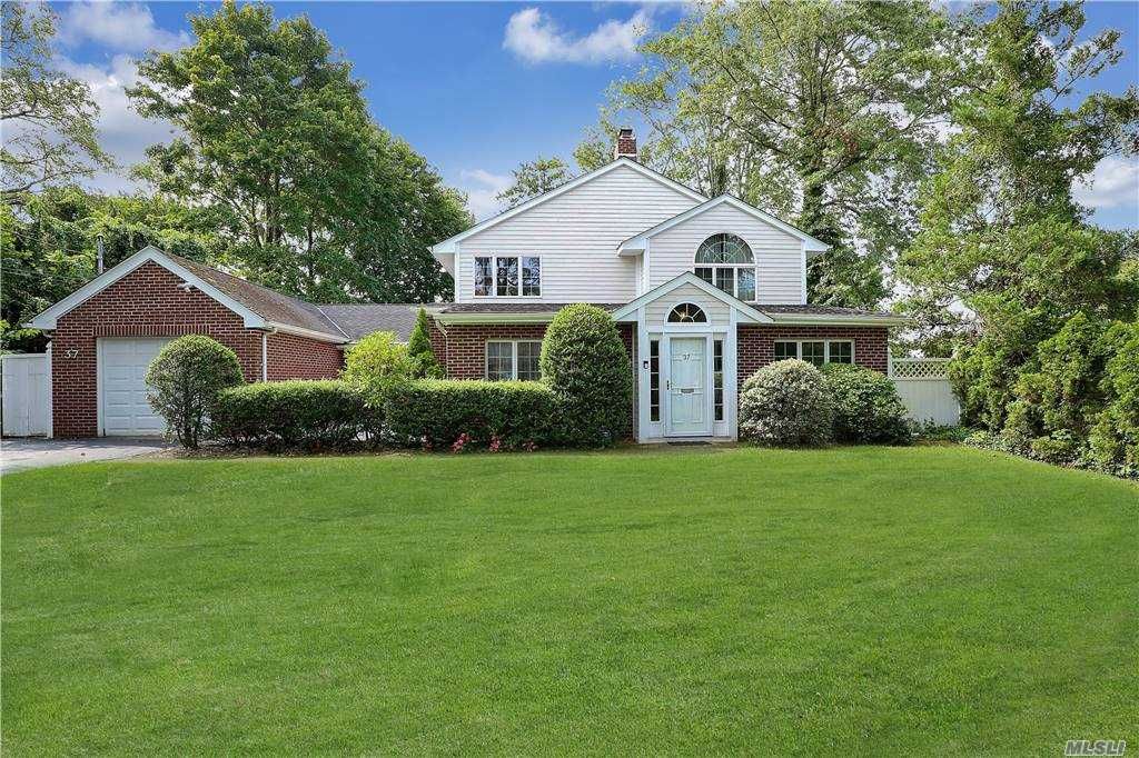 Perfectly Situated In The Heart Of Flower Hill Sec. Of Roslyn. This 5 Bedroom Colonial Is Ideal For Entertaining With Open Floor Concept. Spacious Principal Rooms With Vaulted Ceilings, Remodeled Eat In Kitchen with GE Cafe Appliances, Large Pantry and Radiant Heat Floors, Wood Flooring Throughout. Generously Sized Master Suite With Designer Bath. Outdoor Living At Its Finest... Beautiful Stone Patio With Outdoor Kitchen and Fireplace. Port Washington Train Sticker. Roslyn Schools. Make This Your Dream Home Today.