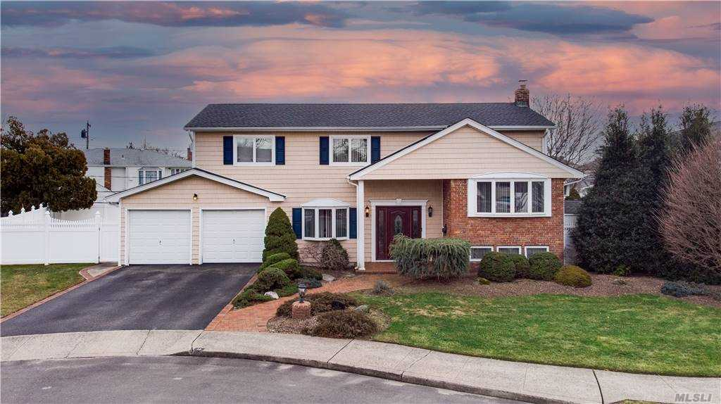 Beautiful multi level splanch with lots of room to stretch out. Beautifully finished hardwood floors throughtout 2nd floor. Master bedroom with full bath. Plenty of closets throught for storage galore. 1st floor laundry room with mudroom. Family room with sliding glass doors leading out to patio overlooking spacious fenced in yard. New roof less than a year old, Owned Solar Panel System which relates to extremely low electric bills. This is a MUST SEE home. Call Dawn D'Andraia Listing Agent to make appointment to see the home @347-551-2849.