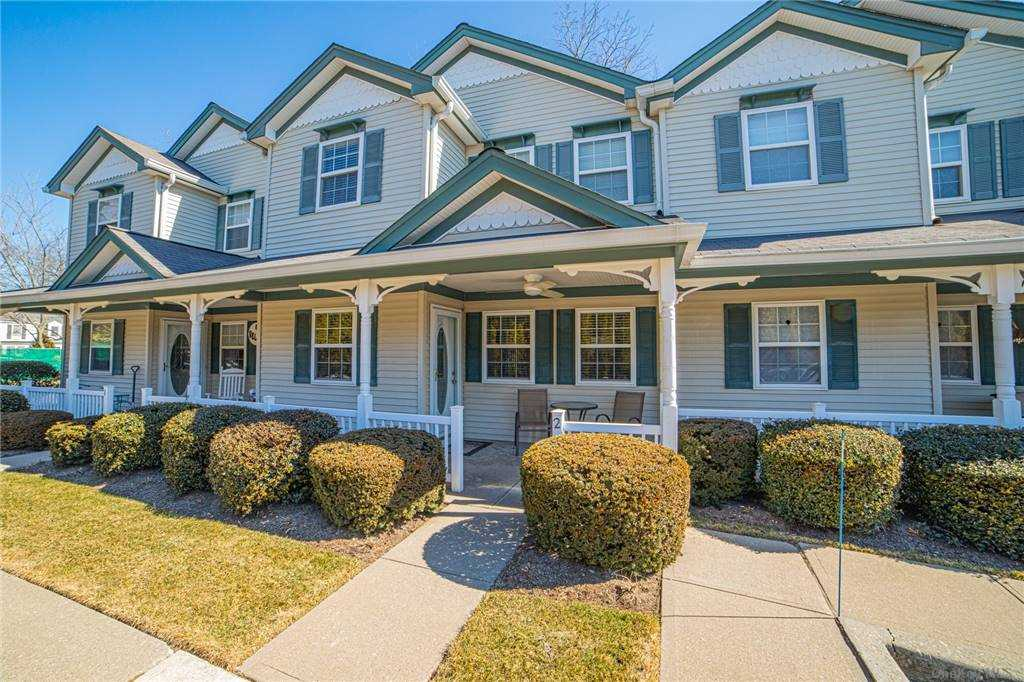 """Sale may be subject to term & conditions of an offering plan. Kick Back and Relax in this Diamond 2 Bedroom 1.5 Bath Town-House Style Condo. Nestled in the Quaint Community of Amityville Village, this Unit Features an Eat in Kitchen w/Breakfast Bar, Dining Area w/Sliders to Private Paver Patio, Large Living Room, Laundry Room, Master Bedroom w/Walk in Closet, """"Jack & Jill"""" Entrance to Master Bath & Quest Room w/Views of Lake. Updated Gas/HA/CAC Recessed Lighting &  Hardwood Floors Thru Out. 2 Car Off Street Parking, Community Shed for Storage. Taxes $7975 Before Exemptions! Monthly Common Charges $450"""