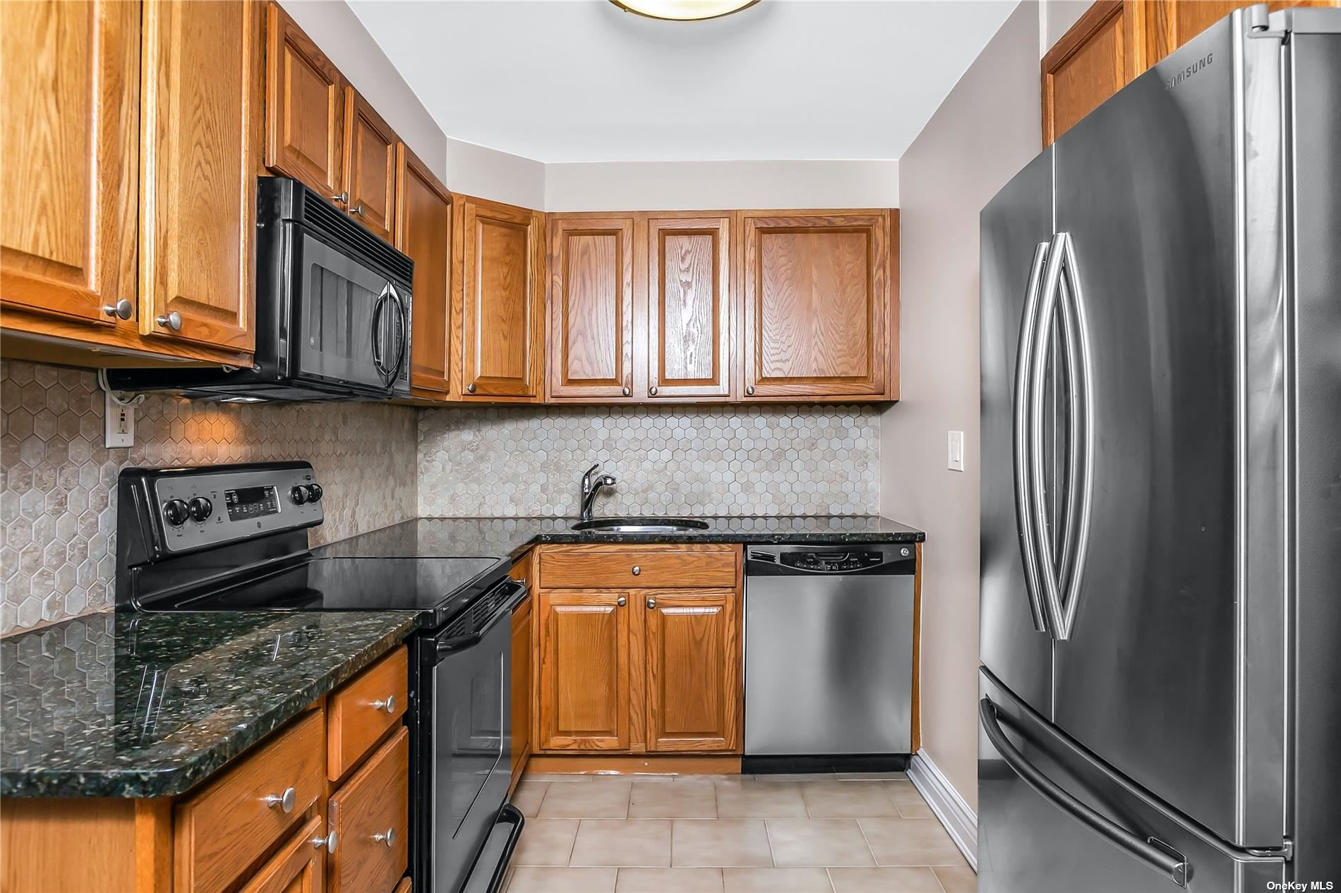 Move right into this Sundrenched unit with Open views for privacy -Stunning wood floors throughout- Maple wood cabinets in kitchen with granite countertops and stainless appliances.  Euro Bath with ceramic tiles...Flat ceilings -steps from prime parking space paid by buyer (8,500)  Pools, health club and tennis on grounds...
