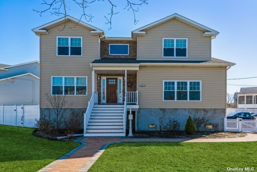 Amazing Waterfront Living! Move right into this Fantastic, Built From the Ground Up in 2019, Light & Bright Colonial on Over-Sized Property!  Huge Rooms, 4 Bedrooms (Master is a True Suite) 2.5 Baths, EIK w/SS, Large LR, Formal DR, Den, Gleaming Hardwood Floors Through-Out, CAC, 2.5 Car Garage.  ALL NEWLY ADDED: PVC Fencing, Stonework Patio, Outside Kitchen, Custom Window Shades, New Deck w/ 4 Piles, Boardwalk.   DOES NOT NEED FLOOD INSURANCE.  Built Flood Compliant.  A MUST SEE HOME!