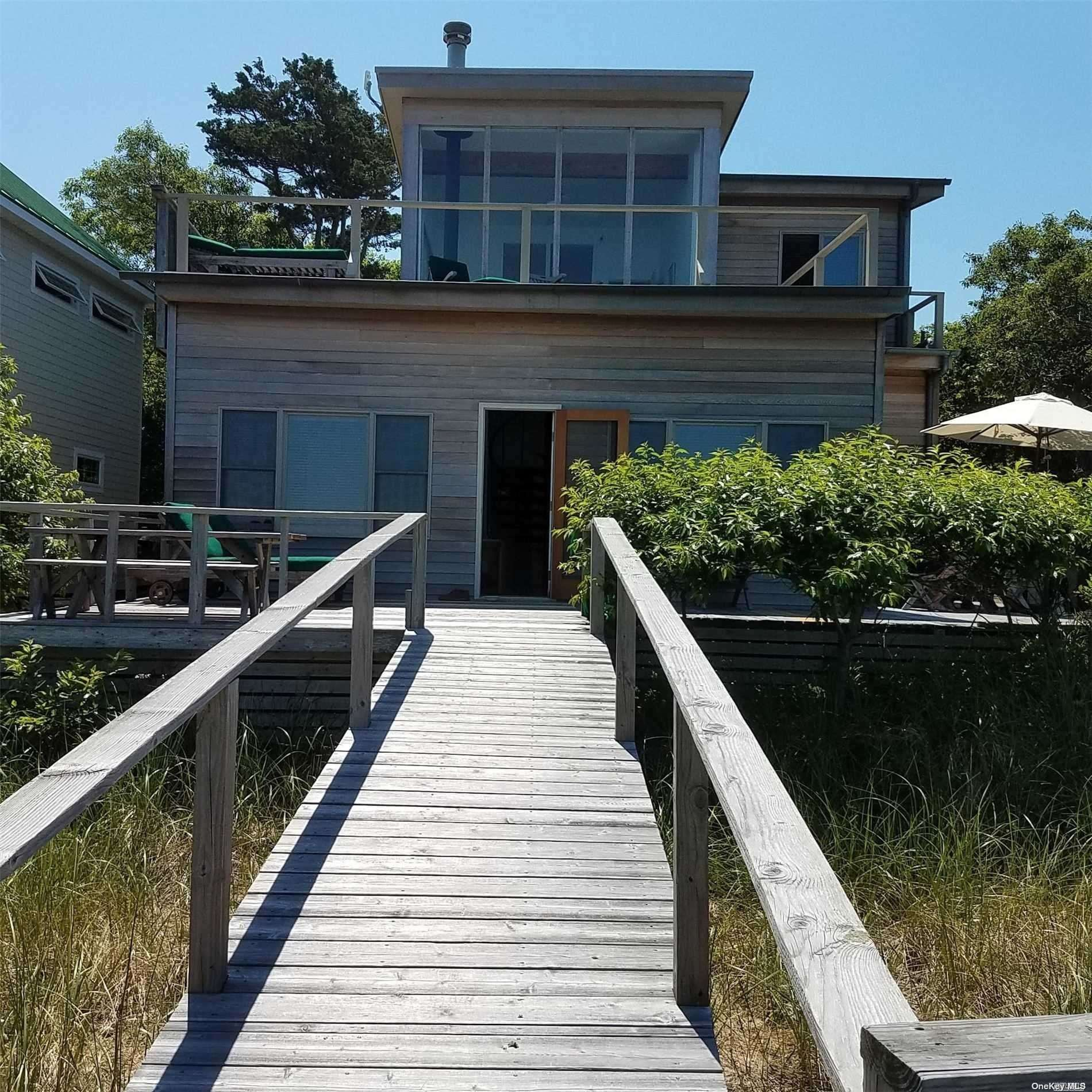 FABULOUS COMP. BEACH HOUSE IN WATER ISLAND. THE DOWN STAIRS HAS LIV/DIN/KIT COMBO 2 BEDROOMS AND 1 BATH, IT HAS HIGH CEILING AND GREAT VIEWS. UP-STAIRS THERE IS A BEDROOM WITH A SITTING AREA PLUS A BALONIE AND 1/2 BATH. THIS AREA ALSO HAS AN OUTDOOR DECK WITH WONDERFUL VIEWS. IT'S ONE OF A KIND, NOT TO BE MISSED