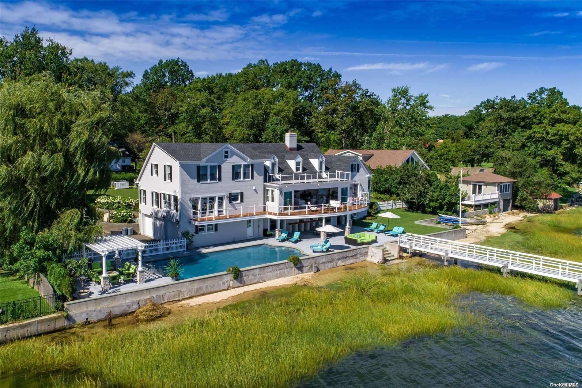 Gated Waterfront Colonial Totally Renovated With Exquisite Touches Throughout and Private Dock Overlooking Oyster Bay Harbor. Notable Features Include Spectacular Family Room With Sliding Doors and Walk Out Lower Level to a Beautiful Stone Patio, Gunite Pool, and 200 Ft Of Private Beach that are Perfect for Entertaining in Your Own Private Paradise. Cul De Sac Location, 3 Car Garage, Generator, True Summer Oasis! Alternative To The Hamptons!