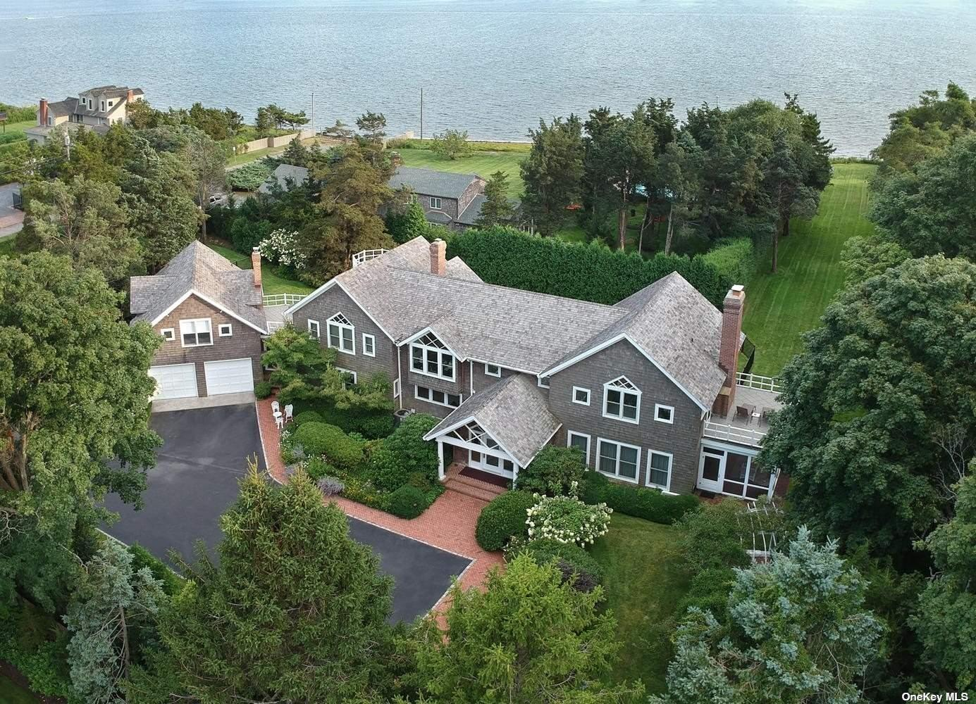 Set Back Nearly 300' From Waters Edge Sits this 5100' Sqft Home in Bellport Village with 50' of Private Beach Front On 1.1 Acres. Entering the Light Filled House from a Long Landscaped Driveway, the Main Level Boasts a Grand Formal Entrance Leading to the Formal Living Room & Dining Room Flanked with Sliding Doors to the Pool Patio & Gas Fireplaces. Adjacent the Living Room is a Screened Porch with Direct Bay Views. A Picture-Perfect Setting for Entertaining, the House Offers Well-Proportioned Rooms and Gracious Open Floor Plan. The 2nd Floor has a Master Bedroom Ensuite w/ Private Access to a Balcony Overlooking the Bay, 2 Walk-In Closets, Gas Fireplace & Marble Bathroom. Pass Through 2nd Level Den w/ Cathedral Ceilings to the Guest Bedrooms Each with Access to a Private Terrace Leading to Separate Guest Quarters w/ Kitchenette & Full Bathroom. Expansive Outdoor Brick Patio Surrounds 14x28 In-Ground Htd Pool. Privacy & Serenity in Every Corner of this Elegant Property!