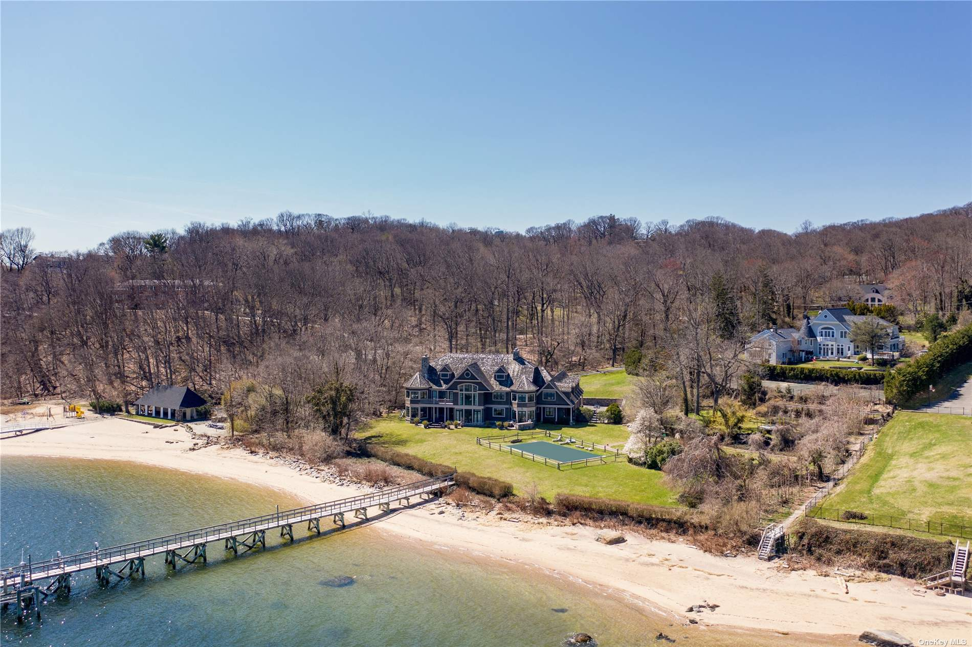 Welcome to 263 Harbor Acres Road, a beautiful 6 bedroom and 7 bathroom Hamptons style shingle home built in 2004 on over 4 acres of prime waterfront land in the esteemed Village of Sands Point. This exceptional property features 360ft of water frontage, an in-ground pool, deep water dock, tennis court, a prolonged tree lined driveway, a built-in outdoor stone kitchen and patio, a elevated garden with fountain and access to your very own private, sandy beach- all emphasizing the breathtaking views of the harbor.