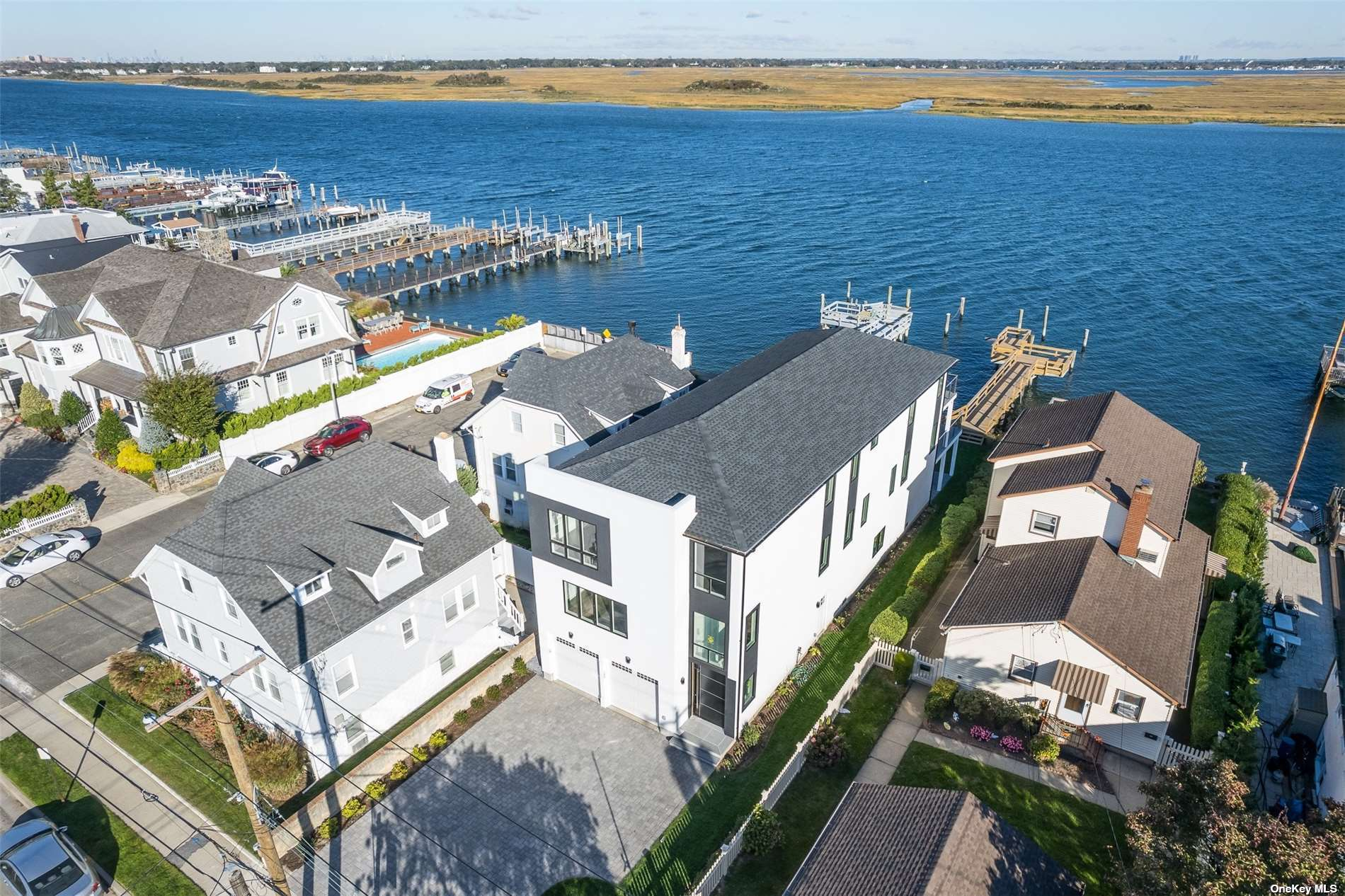 Experience Bayfront Luxury in this 4,000 sq.ft. FEMA Compliant Brand New 4 Bedr, 3.5 Bath Contemporary in the Artsy West End! Great room has open layout so you will see the bay from wherever you are: in your family room, eat in kitchen, formal dining room, and living room w/fireplace, sliders to oversized decking from which you can access the beautifully landscaped yard, patio, and dock with a sitting area. Upstairs there are 2 master bedroom suites (North-facing and South-facing) each has own bathroom, the bay facing one has sliders to a bay front decking... there are also 2 guest bedrooms that share one full bathroom. Laundry, closet galore, large bedrooms, CAC w/3 zones, top quality finishing materials, beach inspired colors, come home to serenity, bring your boat, kayak, fishing rods... Perfectly designed for indoor outdoor entertaining. Still time to customize... Plans in my office & can arrange meeting with the builder... Under 1hr to NYC, near cafes, shops & beach!!!!