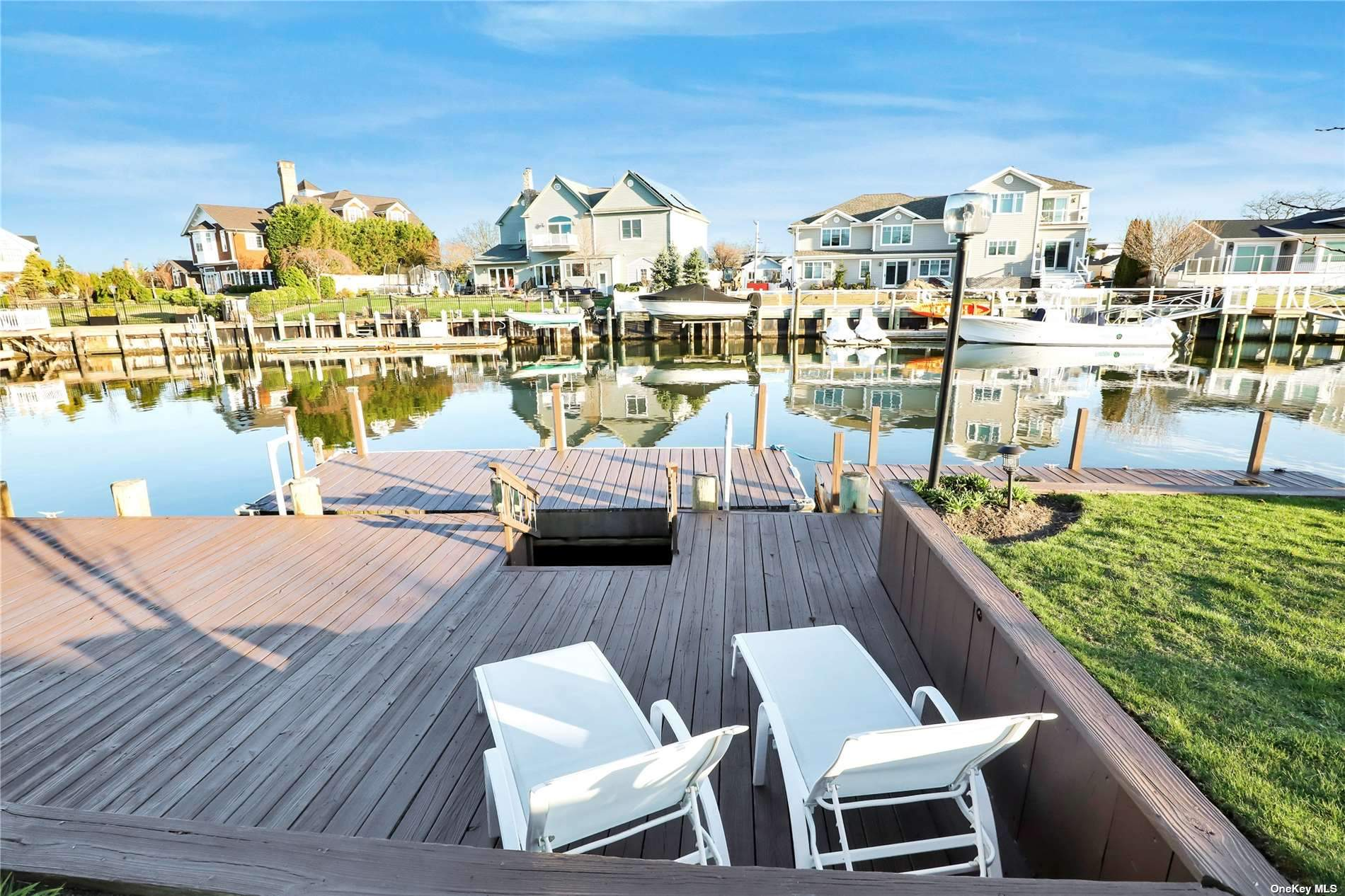 Biltmore Shores Waterfront Sprawling Split Level located on Wide Part of Canal, Seconds to Bay and Biltmore Beach Club  Membership required, 89 ft of Bulkhead and 2 Floating Docks, Brick Walkway, Blue Stone Front Stoop, Vinyl Siding, Vaulted Entry and Baths, Hardwood Floors as Seen, Gas Heating, Rheem Central Air Conditioning, 200 Amps, Wood Burning Fireplace in Family Room with Andersen Slider out to Rear Yard, Casement and Replacement Windows, 3 year Old Roof, 2 Car Garage and Driveway, Large Bedrooms with Walk In and Double Closets, Pull Down Attic Stairs, Gas Cooking, Hi Hats, Plenty of Storage, Great Waterfront Home 64 wide in front fans out to 89 wide in back ...110 deep with Generous Living Space and Setting.