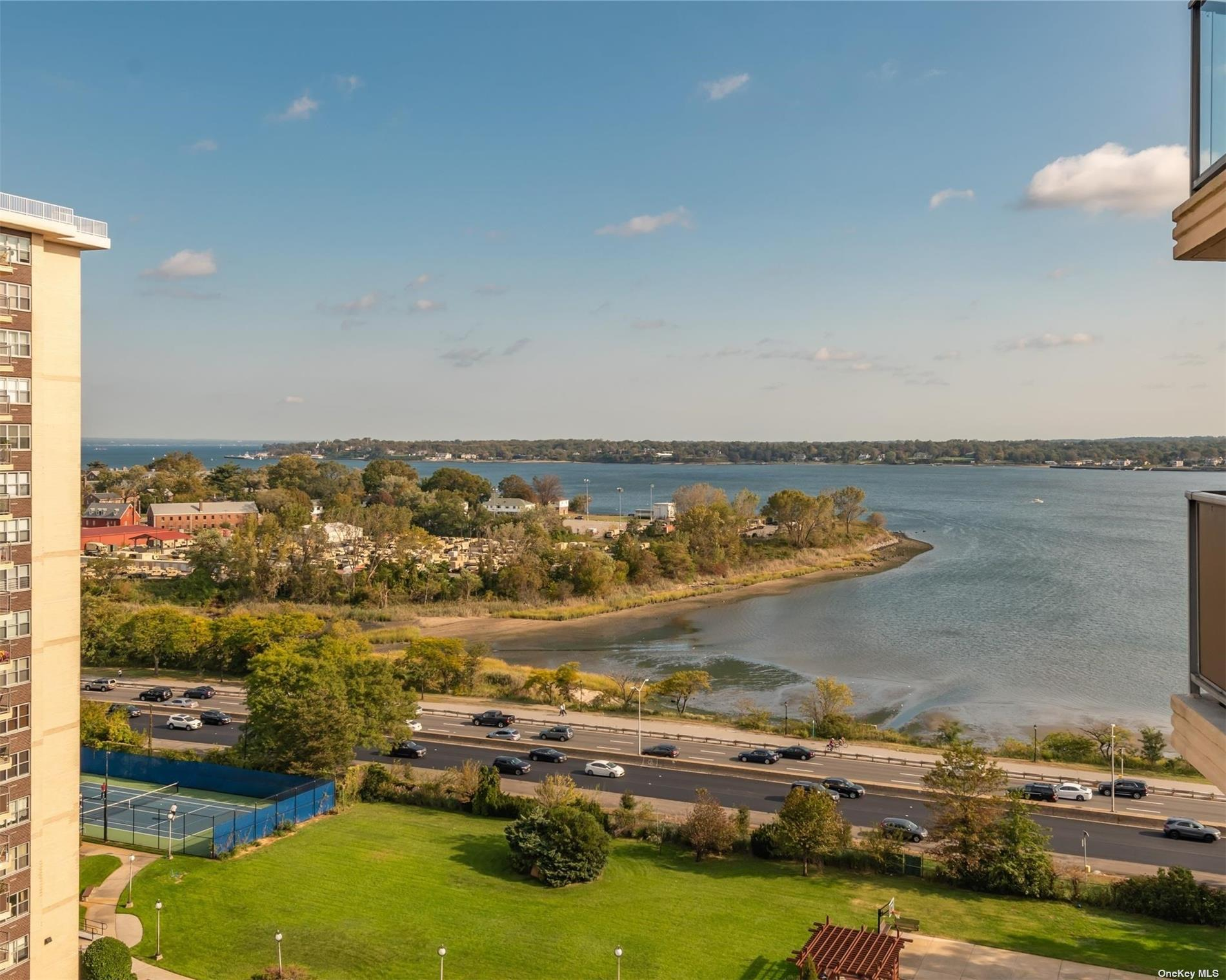 Renovated apartment on high floor with expansive views of Little Neck Bay, Whitestone Bridge and Manhattan Skyline!  Kitchen boasts custom wood cabinets, granite countertops and a full suite of high end appliances. Spacious living/dining area leads to your private balcony.  King sized bedroom has enormous walk-in closet.  Bathroom has marble vanity and ceramic tile. Hardwood floors, crown molding and generous closets throughout.  Amenities @ Towers @ Water's Edge include 24 hour doorman, concierge service, indoor parking garage ($), state of the art gym/spa with sauna and steam room, summer pool, tennis, restaurant, salon, dry cleaner and laundry.  You will love living here!