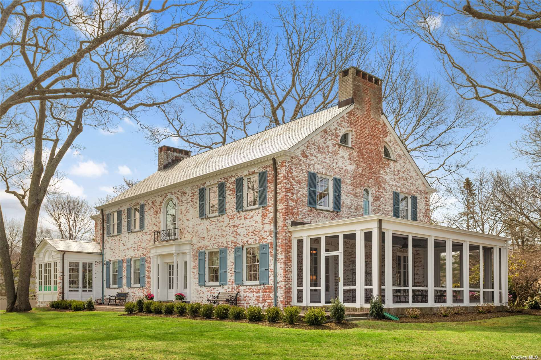 New to the Market! Original Gatsby-era estate home on shy acre with water views, deeded bay beach and protected deep water dock with direct access to the bay. Originally part of 100-acre estate, this Georgian manor home is in the desirable waterfront community of Harbor Lights. The home has been meticulously restored to it's original grandeur and updated with modern kitchen, central air, efficient heating system, and slate roof. Original features include a grand entry hall, formal living room and dining room- both with fireplaces, original wood-paneled library/office with fireplace, breakfast room, butler's pantry, kitchen.  Large screened in porch with water views off the living room. Master ensuite with private morning room/office, guest ensuite, 3 additional bedrooms and 2 baths. Five bedrooms, two sitting rooms, four full & 2 half baths in all. This grand, historic home is a once-in-a-lifetime opportunity!