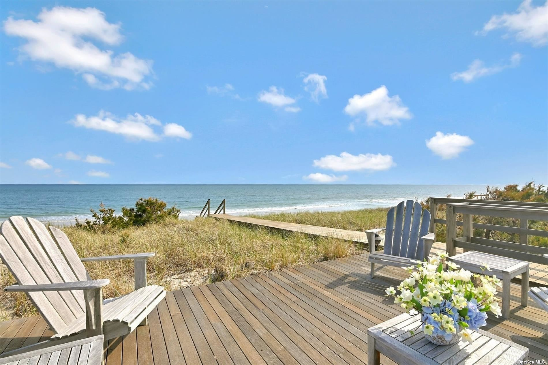 Revel in life and make amazing memories in laid back luxury in this oceanfront home in Quogue, one of the most desirable areas of the world famous Hamptons.  This beautifully designed home offers all the amenities one could want. Seven beautiful bedrooms, six with their own baths, an awesome master bedroom and bath, two half baths, a living room, formal dining room, spectacular kitchen, a family room, billiard room, elevator, fireplaces everywhere, an enormous swimming pool area with heated gunite swimming pool and decks, 3 car garage, whole house backup generator, gorgeous landscaping and your own access to the pristine beach.  And more.  Only one word to describe this offering:  FABULOUS!