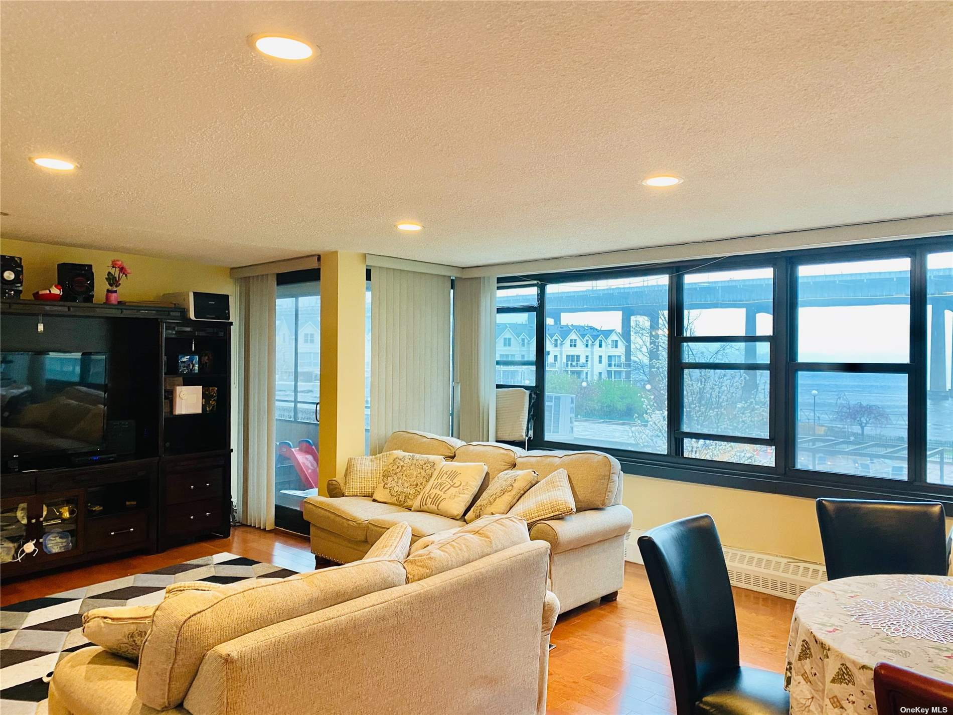 Prime location Waterfront eastern exposure boasting water and bridge views...Renovated Kitchen and bath with laminate flooring in living room and dining room/updated bath .recessed lighting .prime parking space available for transfer