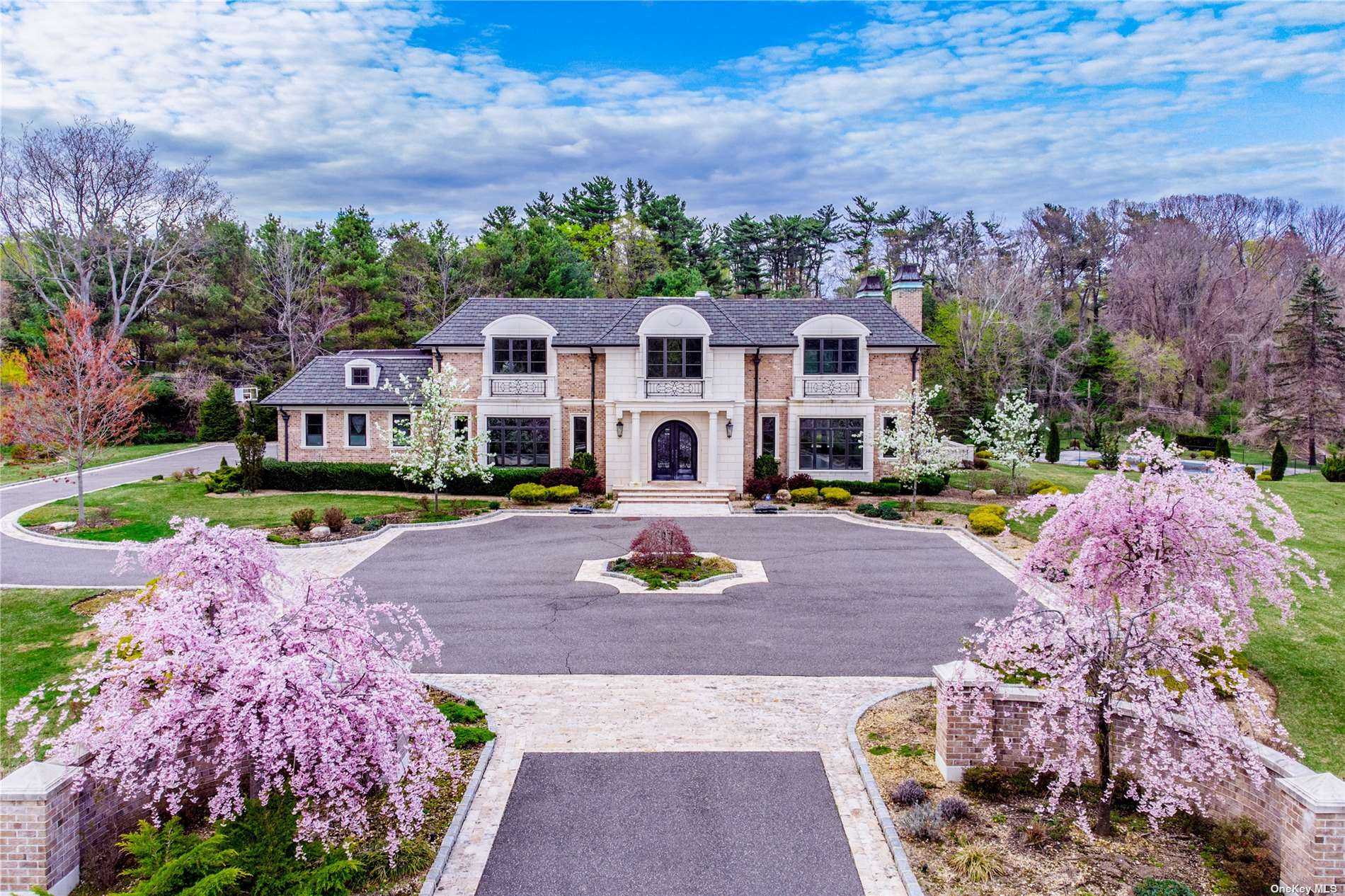 Masonry Colonial Built in 2015 in Old Westbury, A Well-known Community, With an Open Terrain.  Three Colleges/Universities Around and Kids Can Go To One of Long Island's Best School Districts - Jericho. Expanding More Than 2 Acres and Gate facing South. Offering Luxurious 7 bedrooms, 6.5 bathrooms, A 3-Car Garage, and a Generous shy 6,000 sq ft Living Space. Has Smart Home System, Floor Heating, Indoor elevator, Home Movie Theater, Gym, Wine Cellar, Heated Swimming Pool, and More. A Stunning and Magnificent Home to Own!