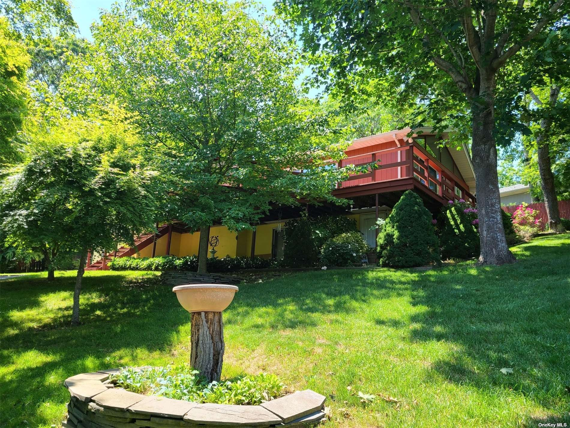 Wonderful Opportunity to Buy a Year-Round Residence or Gateway to the Hamptons Vacation Home Centrally Located in the Heart of Hampton Bays Just Minutes Away from the Shinnecock Canal, Shinnecock Marina, Waterfront Restaurants and Newly Restored Canoe Place Inn, the Oldest Inn in America! 1st Time on the Market! Raised Ranch with 1,367 SF Features Great Room Lay-out with Cathedral Ceiling, Living Room with Fireplace, Dining Room, and Kitchen Surrounded by Sliding Doors. Master Bedroom with Master Bath, 2 More Bedrooms & Full Bath. Lower Level has Full Finished Basement with Ground Level Entrance with Family Room, Summer Kitchen, Office, Walk-In-Closet, 3rd Full Bath & Entry From Garage. Beautiful Setting on .27 Acres with Decks Around House, Oil Hot Air Heat, Central Air Conditioning, Inground Sprinklers, Architectural Roof & Low Taxes of $6,827.