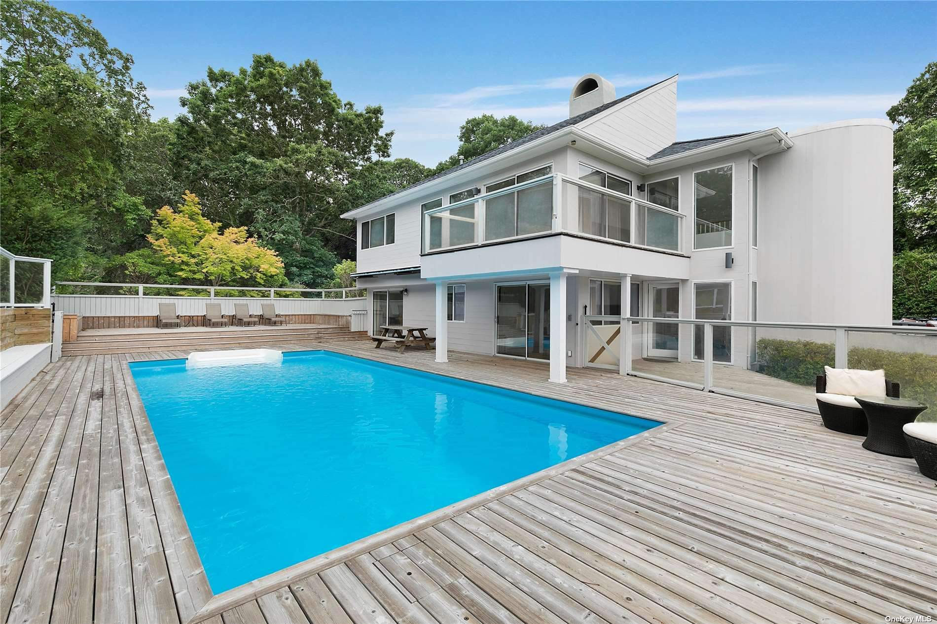 Directly across from Cold Spring Pond sits a 3 bed 3 bath contemporary on 1+ acre. Stunning views of from Kitchen, dining and living room. Spacious and open inside. Outside, an IG pool, outdoor fire place and private beach. Grab your paddle boards and head to this fabulous Southampton hideaway!