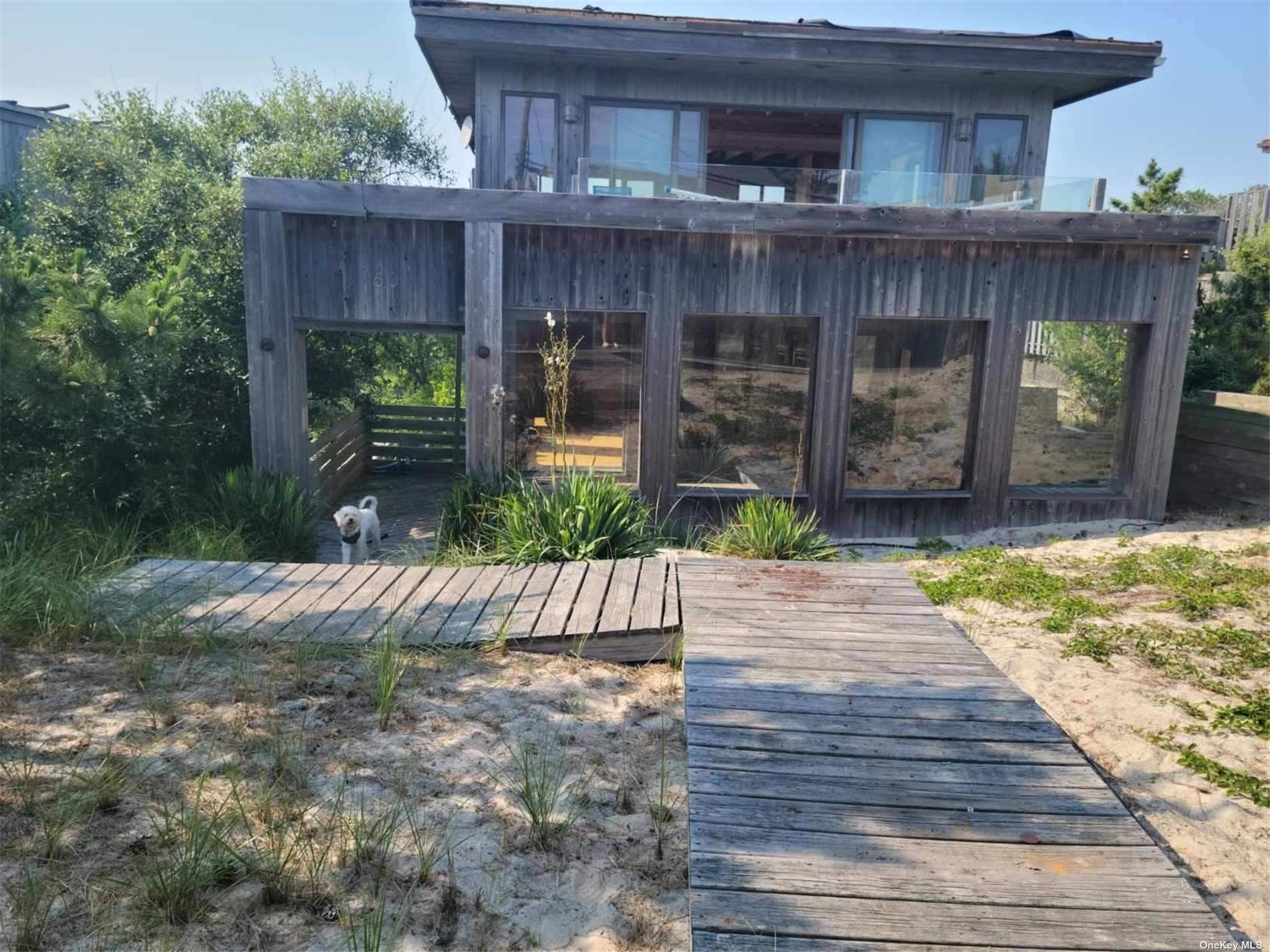 """Great opportunity to own a home in the Fire Island Pines,  Great Rental Possibility. Price based on Sale """"AS IS"""" or Fully Renovated Priced at $1,200,000 .3 Bedroom 3.5 Bath Contemporary w/ Master Bedroom, Master Bathroom on Main Floor.  2nd & 3rd Bedroom w/ Private Bathrooms.  Kitchen w/ Balcony.  Dining Room & Living Room w/ Cathedral Ceilings & Spacious Balcony w/ Water Views.  Den w/ sliders to back deck."""