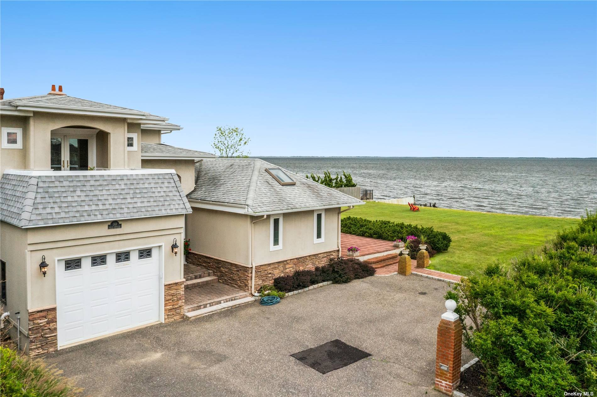 If you are searching for a home that offers magnificent views of the Great South Bay, located at the end of coveted South Ocean Avenue with 210 feet of bulkheading and private beach, this could be your new home. Enter the dramatic two story staircase foyer to a spacious open floorplan consisting of living room, dining room, eat-in kitchen, den with a fireplace, and master bedroom suite - all with dramatic waterfront views. Second floor offers two bedrooms, full bath, and a spacious loft area leading to a picturesque deck with unparalleled evening sunset views. This home offers a full finished basement with wet bar and bath and a one car attached garage. Do not miss the virtual tour to experience the views this home offers firsthand!
