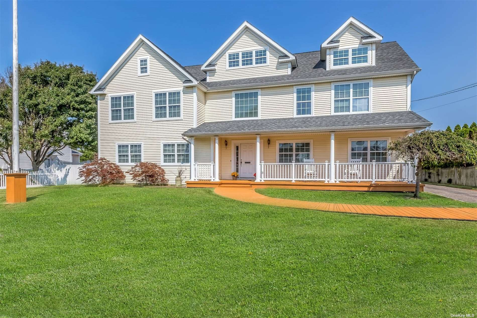 Superb location in South Sayville, with Bay and Canal views! Bright and sunny; this updated colonial offers an open floor plan and generously sized rooms. Welcoming front porch, double height entry foyer, hardwood floors, big and comfy great room, home office, wide open kitchen, dining and sitting area, full bathroom, plus laundry/mud room make up the first level. The upstairs bedrooms, with water views and high ceilings, all have unique architectural touches. The oversized master features two walk in closets and an office nook. The full stand up attic space is fantastic for storage. Nice sized property with detached two car garage and long private driveway. If you always wanted to be nestled in a waterfront community in a phenomenal town, look no further!
