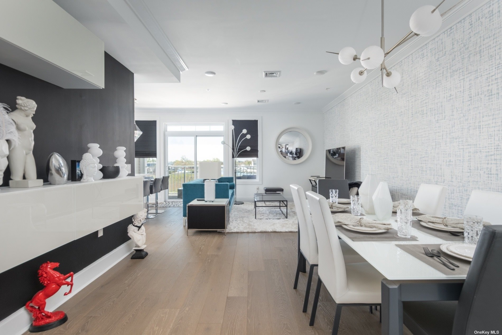 This is a builders unit. He meticulously detailed the interior with top of the line finishes. Upgrades include decorative backsplash, crown molding, wallpaper accent walls (Philip Jeffries), Hudson Valley Lighting, shiplap accent walls and much more.  You will not be disappointed in this unit, you will feel like you are in your own private showroom. 2022 taxes have been successfully revised and will be reduced drastically