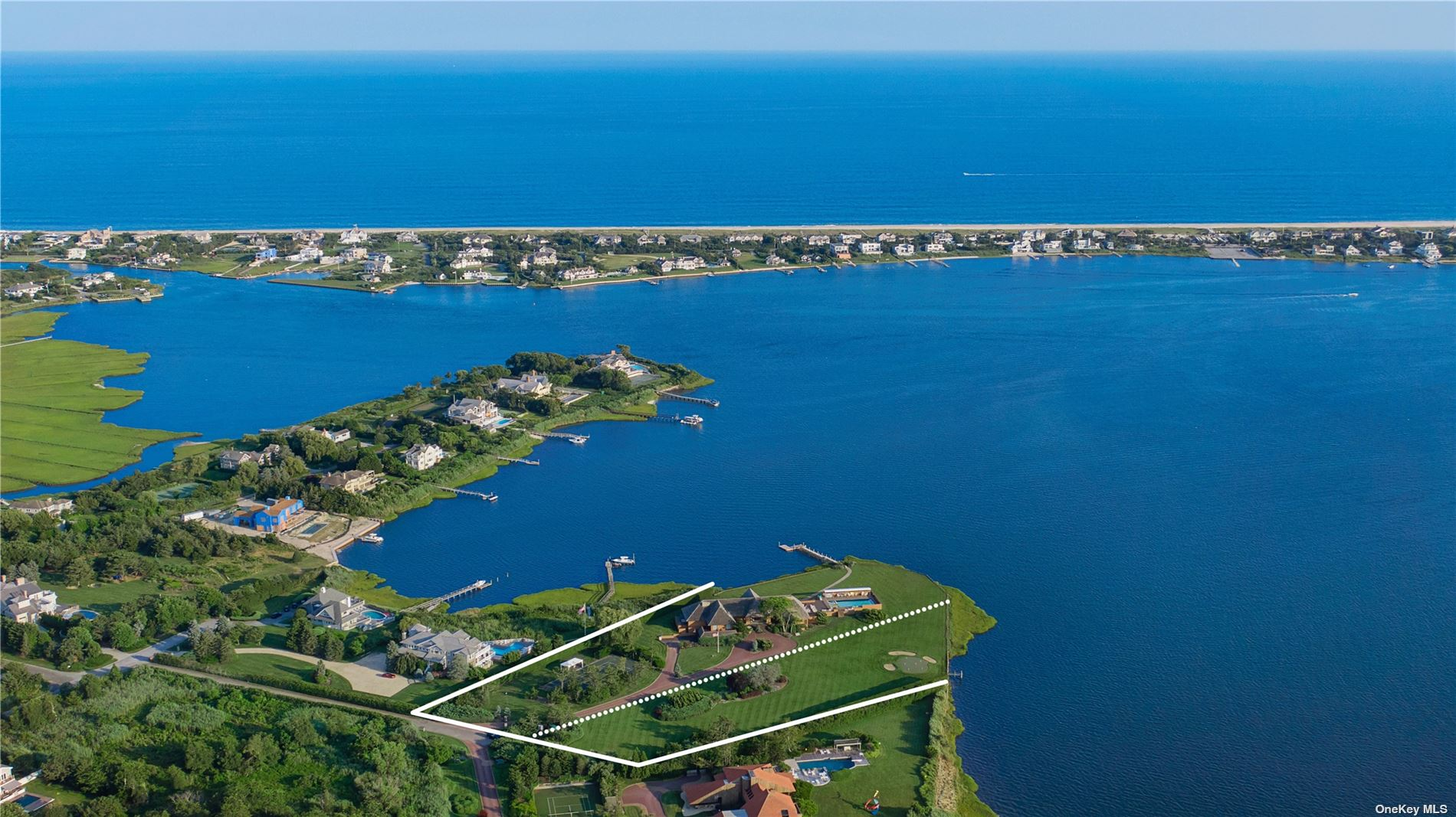 An Impressive And Premier Waterfront Estate Designed By Renowned Architect, Norman Jaffe, In Quogue On The Desirable Quantuck Bay. This Two-Lot Estate Spanning Over 5 Acres and 700 +/- Feet Of Bulkheading Includes Two Docks, Southwest Views From Bay To Ocean, And The Most Spectacular Sunsets, Is Not To Be Missed. With 7,850 +/- sqft., Over 8,000 sqft. Of Outdoor Decking, A 20 x 50 Ft Pool, Spa & Sundeck, Tennis Court, Professional Putting Green, 100 Ft Stationary Pier With 30 Ft Floating Dock, There Is No Need To Look Farther East When You Can Own Your Own Hamptons Waterfront Haven Right In Quogue!