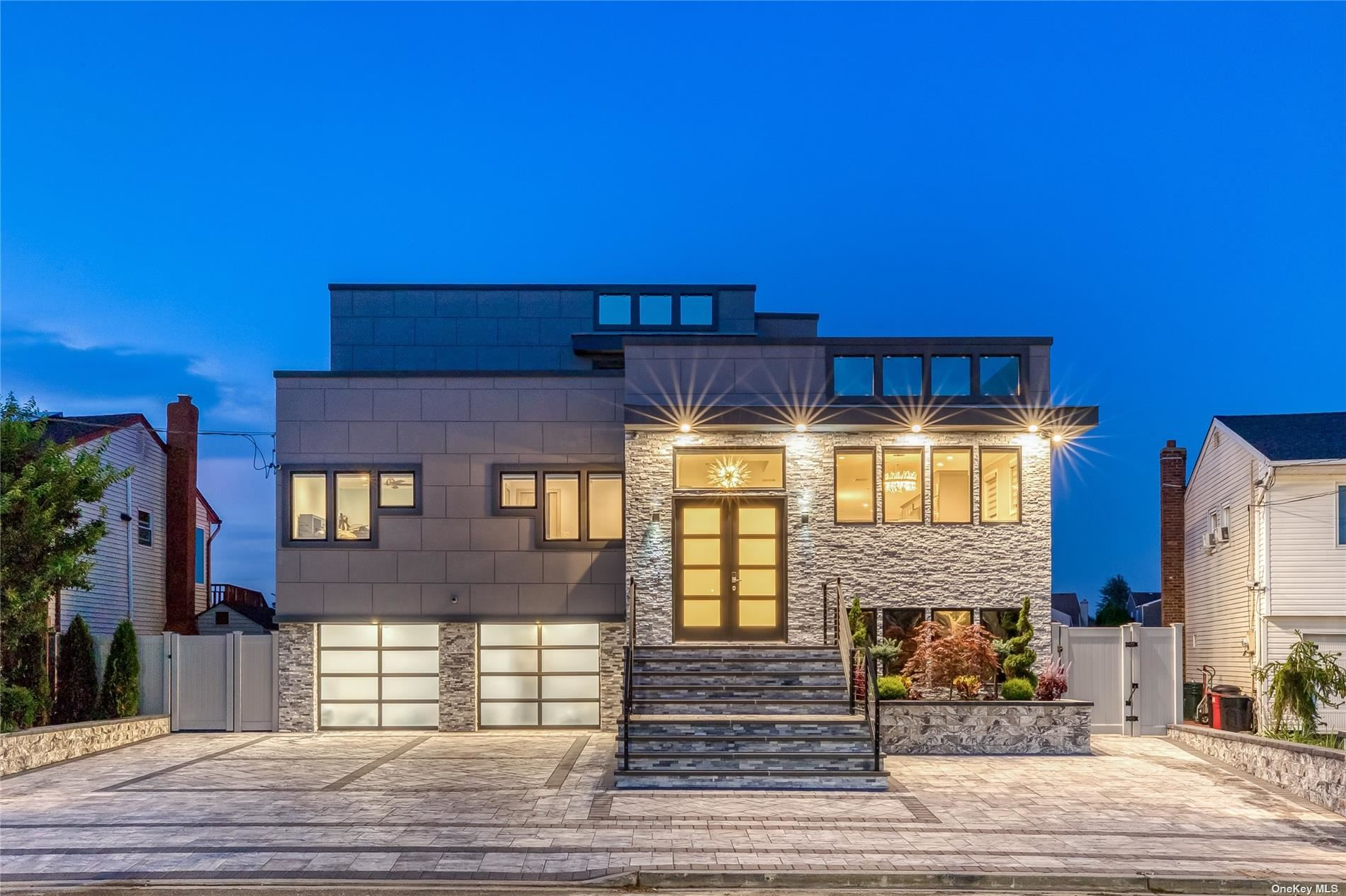"""Welcome To A One-Of-A-Kind, Luxury, Waterfront, 5 Bedroom, 4 Bath Custom Rebuilt Contemporary Style Home. This Home Has Some Of the Most Unique Features Of Any Home In This Area. It's 2 Separate Rooftop Decks Surpass The Height Of Almost Every Home Giving Unobstructed Views Of Jones Beach As Well As A Full Sunrise & Sunset. It's Top-Of-The-Line Chef's Kitchen Features All Wolf Appliances & Oversized Hood, A Quartz Waterfall Countertop & Backsplash, Miele Built-In Coffee Bar,  Chef Sink & A Beautiful Terrace.  The Backyard Is An Entertainer's Dream & Is Equipped With A New Salt Water, Heated, """"Smart"""" Pool With Hot Tub, Hydraulic Cover, 4 Shooting Deck Jets, Lighting & Can All Be Controlled Remotely. It's Outdoor Kitchen Incl. A Built-In BBQ, Ice Maker, Refrig., Bar Sink & Drawers & Granite Bar W. Lighting. The Bulk Head & Pier Are New & Features Underwater Lights. Lutron """"Smart"""" Home Features Bose Bluetooth Backyard System, 16 Cameras, CCT TV W 4K Megapixels & Much Much More."""