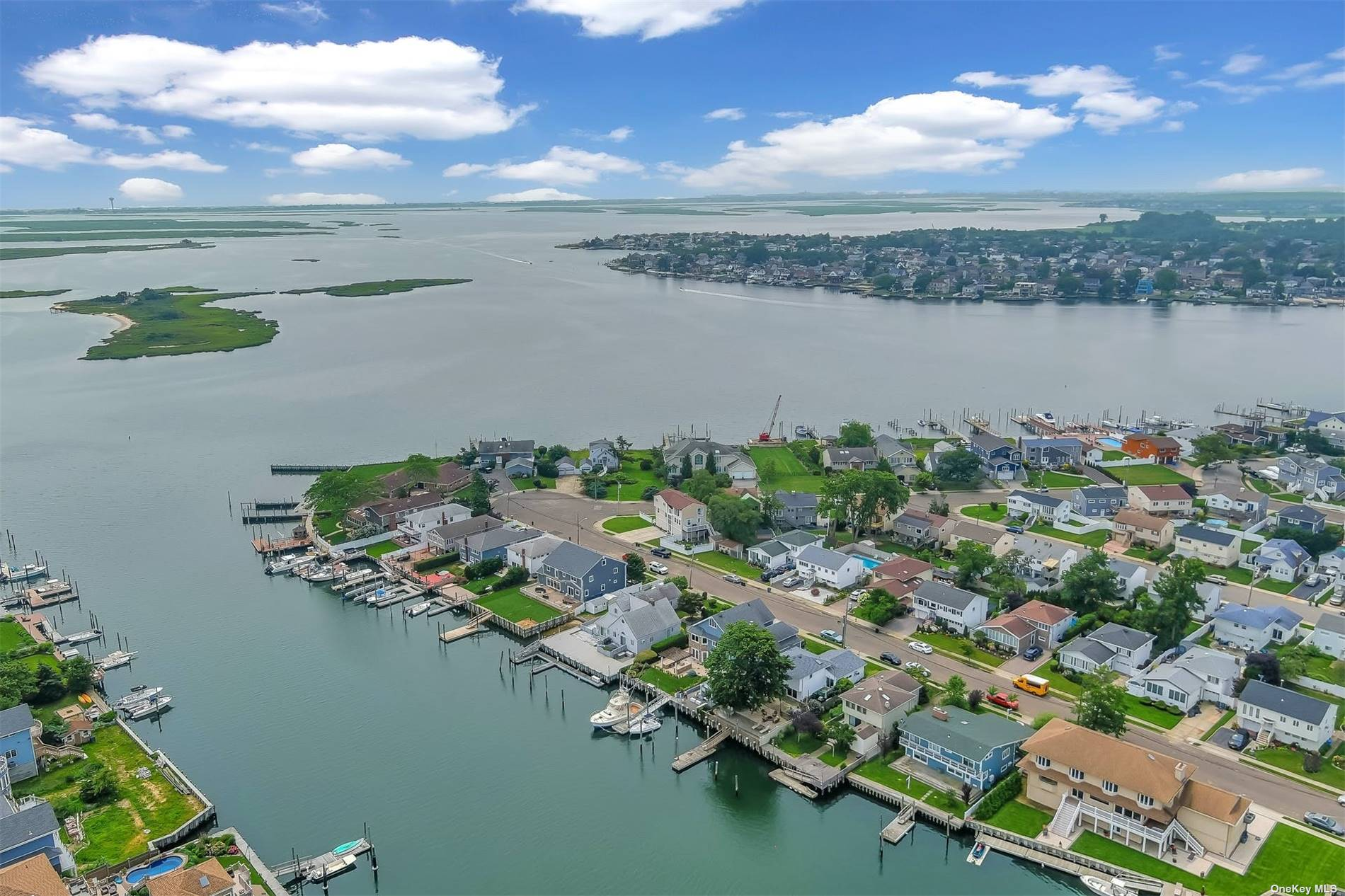 Location, Location, Location! Bring Your Yacht & Enjoy Waterfront Lifestyle in Freeport Deepest & Widest Randall Bay Canal Near Bay & Minutes To Beaches, Split Level Home Offers Lower Level Family Room with Gorgeous Water Views & Leads to 150 Deep Back Yard, Half Bath & Access to Garage, Upper Level Offers Living Room, Formal Dining Room & Eat-In-Kitchen with Water Views & Leads to Deck & Back Yard, 2nd Floor Offers 3 Nice Size Bedrooms & Full Bath w/Skylight, New Roof, Newer Navy Style Bulkhead, Ramp & Floating Dock. Come Home, Relax & Enjoy the Relaxing View & Nature or Hop on the Boat & Take the Family to the Beach or Cruise Around. Long Island is a Great Place to Live!