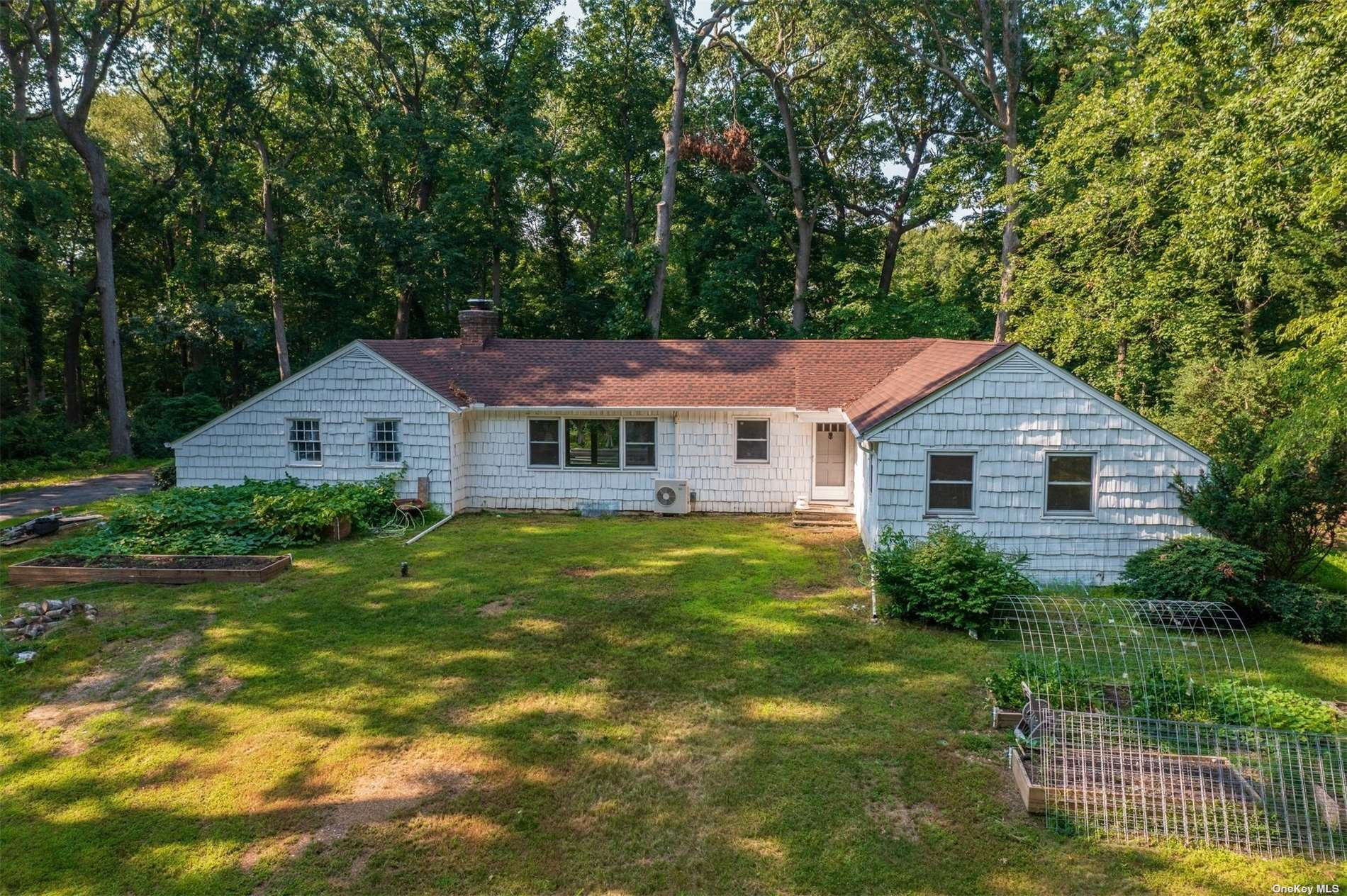 Location! Location! Close to Private Beach, Target Wild Life Preserve & Caumsett State Park. 3 Bedroom, 2 Bath Ranch Nestled on Sprawling 2 Acres w/Wood-Burning Fireplace. Beach Rights.