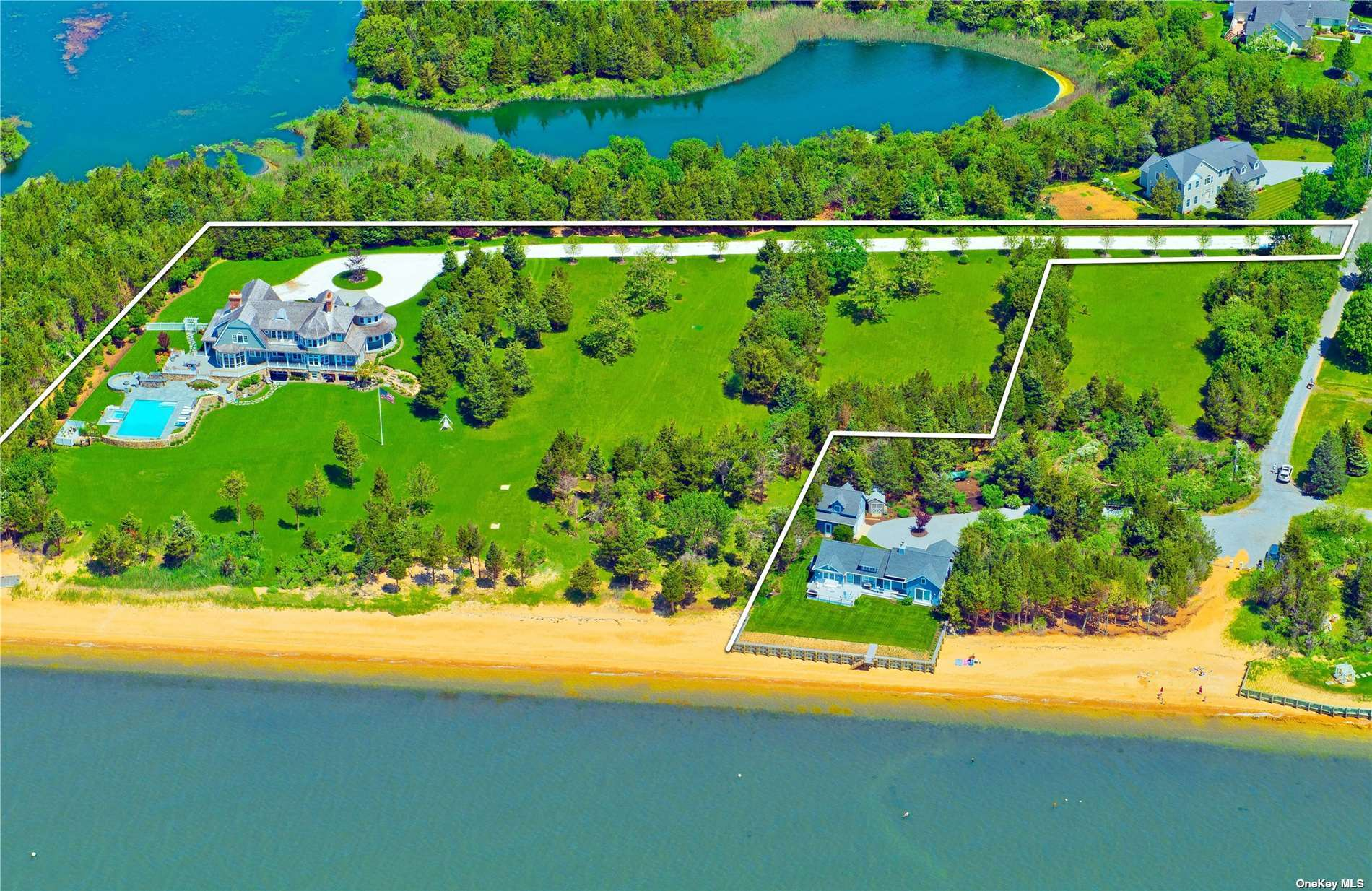 """""""The Esplanade"""", a spectacular Nantucket Style 5-bedroom Bayfront Estate located on the west side of the Bayview Peninsula in Southold, a desirable North Fork location. Surrounded by water and preserved land, this home is custom designed. Recognizing the rarity of this special location the owners of the property accumulated adjoining Bayfront lots over twenty years, creating this private estate and, simultaneously, an exceptional investment opportunity for the future. Three single and separate Bayfront lots make up """"The Esplanade"""" totaling just shy 5 acres, with 400'+ frontage on Peconic Bay. Generous entry, gourmet kitchen designed by Clive Christensen, Waterworks faucets and LeFroy-Brooks shower systems in 4 ensuites, built in Sonos sound systems, butlers pantry with Miele oven, microwave and steam system, 2 sub-zero refrigerator/freeze with wine cabinet. Bluestone deck with mahogany railing overlooks the sprawling lawn to the water's edge with expansive views of Peconic Bay."""