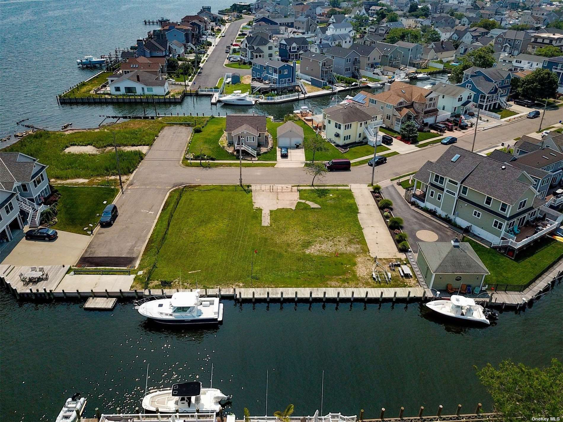Wonderful Opportunity to Build Your Own 3,000 SF House or Be an Investor! 2 Lots Being Sold as One for a Lot Size of 120' x 100'. Situated on a Deep and Wide Canal with Gorgeous Unobstructed Views.