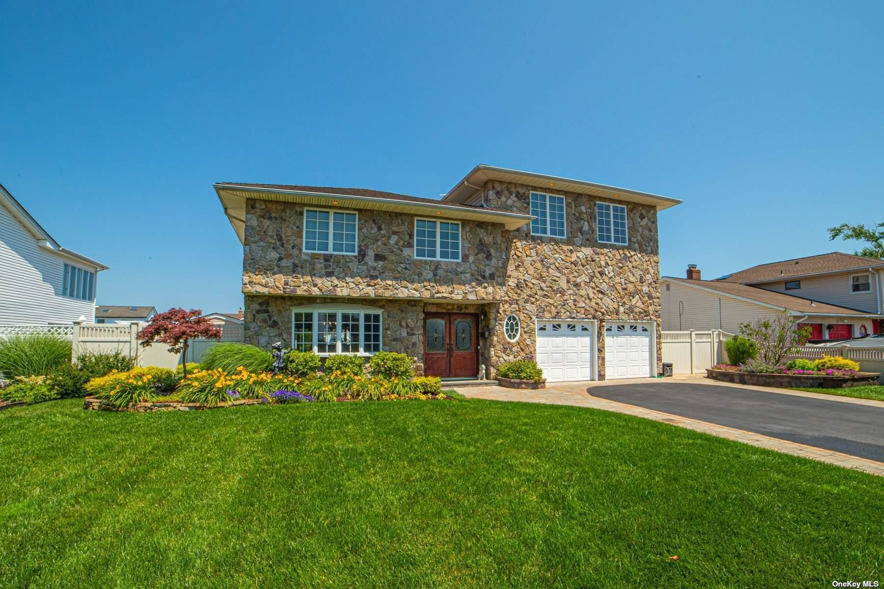 Stunning Updated and Expanded Splanch, Bayviews and Deep water Docking, 75ft Bulkhead w/Elec, 25x25 MBr Suite, w/WIC and AMAZING Views of Great South Bay and Robert Moses Bridge, Country Club Yard Backed by Heated Gunite IGP, Attached Spa, Waterfalls, Wet Bar, Kitchen w/Gas Line for Grill, 3 Stunning Balconies w/Trek Decking Overlooking The Backyard.