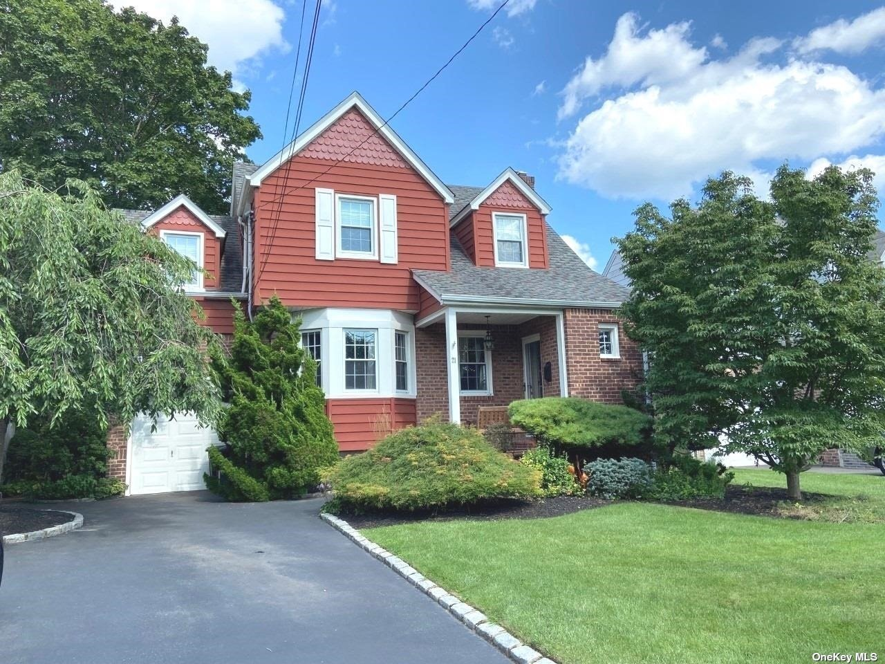 Beautiful 3 bedroom home exudes Charm and Character. Gleaming Hardwood floors throughout upstairs and down. Family room with sklylights and sliders to yard for entertaining. Full finished basement with closets galore! Pull down attic for even more storage. Merrick Schools, Move in Condition!