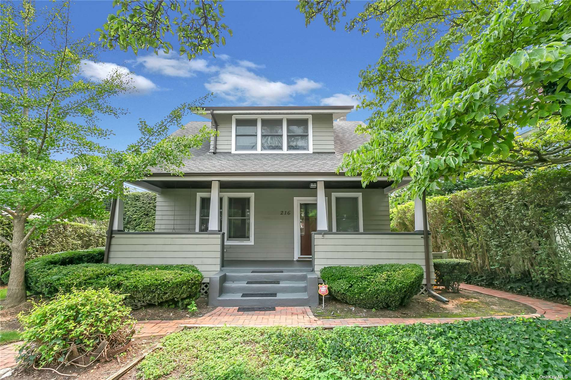 Magnificent, turn of the century Craftsman Colonial w/all the charm of yesteryear, built in 1928, 1690 sq ft  of living space, not including Basement & garage, situated on prime mid-block, Inc. Village, great curb appeal w/beautiful Front Porch w/swing & cedar ext., Living Room & Formal Dining Room both w/refinished hardwood floors, crown moldings & custom built-ins, Eat-in Kitchen w/granite countertops, ceramic tile backsplash, Terracotta tile flr & s/s appliances, 1/2 Bath w/pedestal sink, 2nd Floor 3 BRS all w/refinished hardwood floors & all w/walk-in closets, large ceramic tile Fbth w/vaulted ceiling & skylight, pull-down Attic w/hideaway stairs, Basement finished Family Rm w/wall-to-wall carpeting, all windows have been replaced, refin. hardwood flrs, crown moldings, custom built-ins, wainscoting, CAC, alarm system, 200 amps, gas heat, sep. h/w heater, 2 car det. garage, o/s priv. fenced backyard, 6ft PVC fencing, brick patio, close to town, shopping & R/R, Northside Elem.