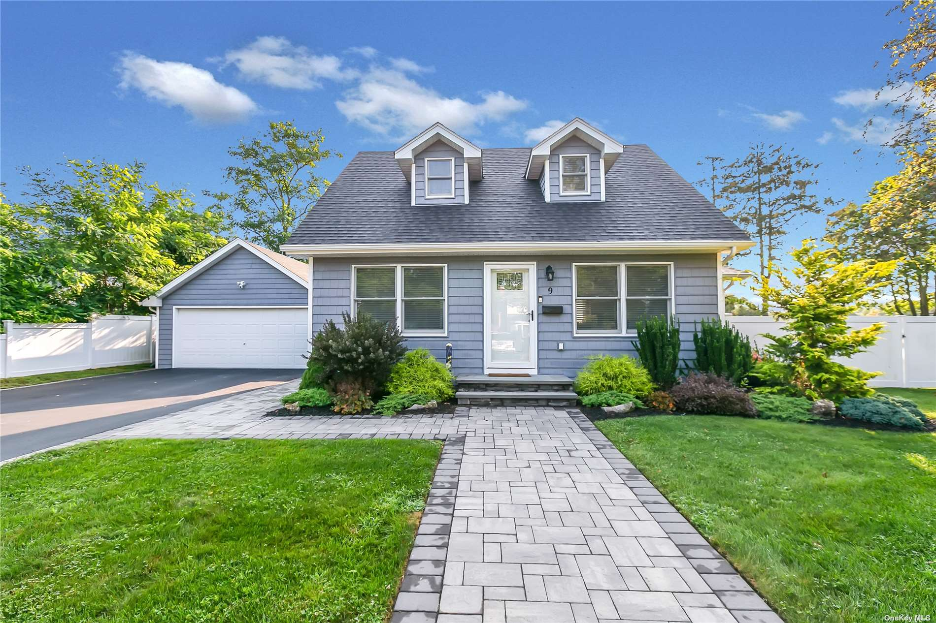 Stunning home on a super large property with beautiful landscaping in the heart of East Islip! Completely renovated just a few years ago and has all the bells and whistles!  Open floor plan with hardwood floors, custom mouldings, quartz kitchen counters, pantry, high-hat lighting, upgraded 200 amp electric, alarm system, 12-zone IGS and more!  Double-wide paved driveway leads to 2 car garage with attached multi-purpose shed is perfect for an outdoor relaxation or entertainment area.  Don't hesitate - this won't be on the market for long!